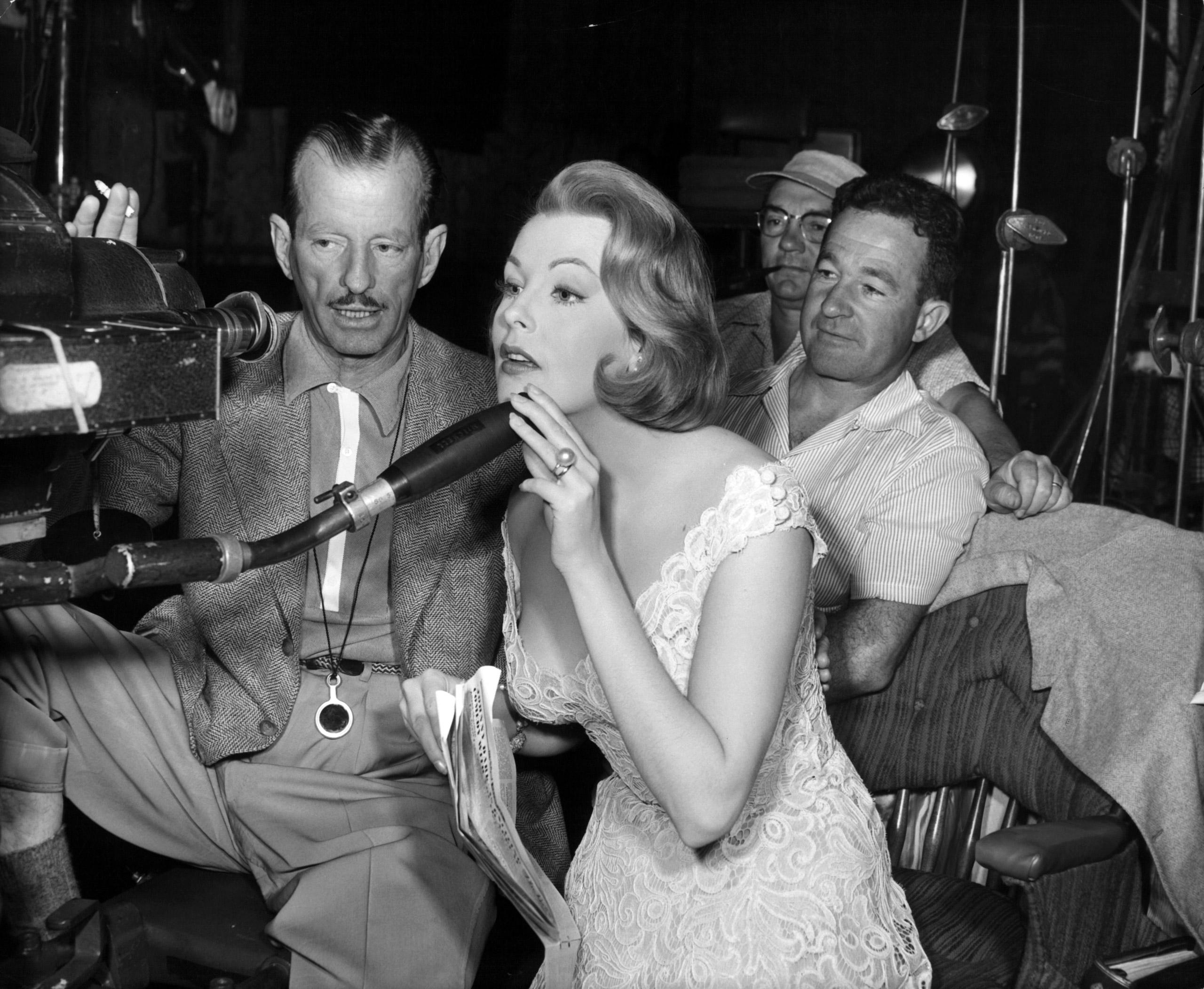 Joseph MacDonald shows Arlene Dahl the mysteries of the CinemaScope Technicolor camera on the set of the film 'Woman's World', 1954.