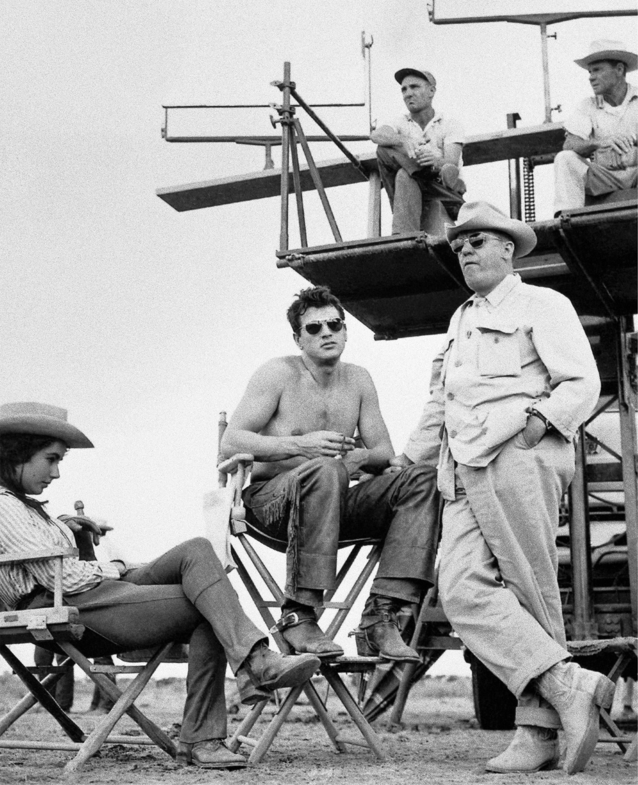 Elizabeth Taylor, actor Rock Hudson and director George Stevens on the set of the movie  Giant,  1956.