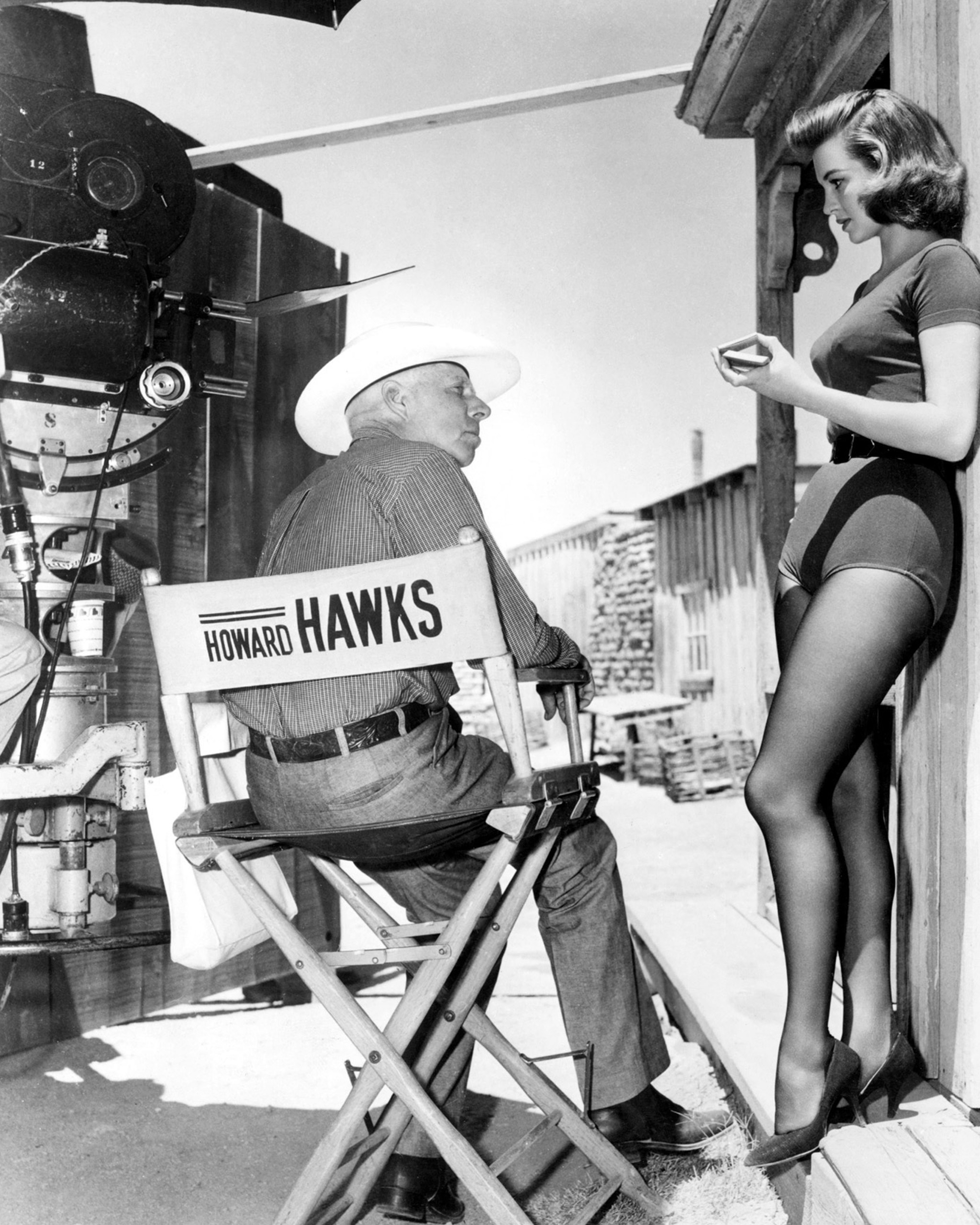 Director Howard Hawks with Angie Dickinson on the set of 'Rio Bravo', 1959.