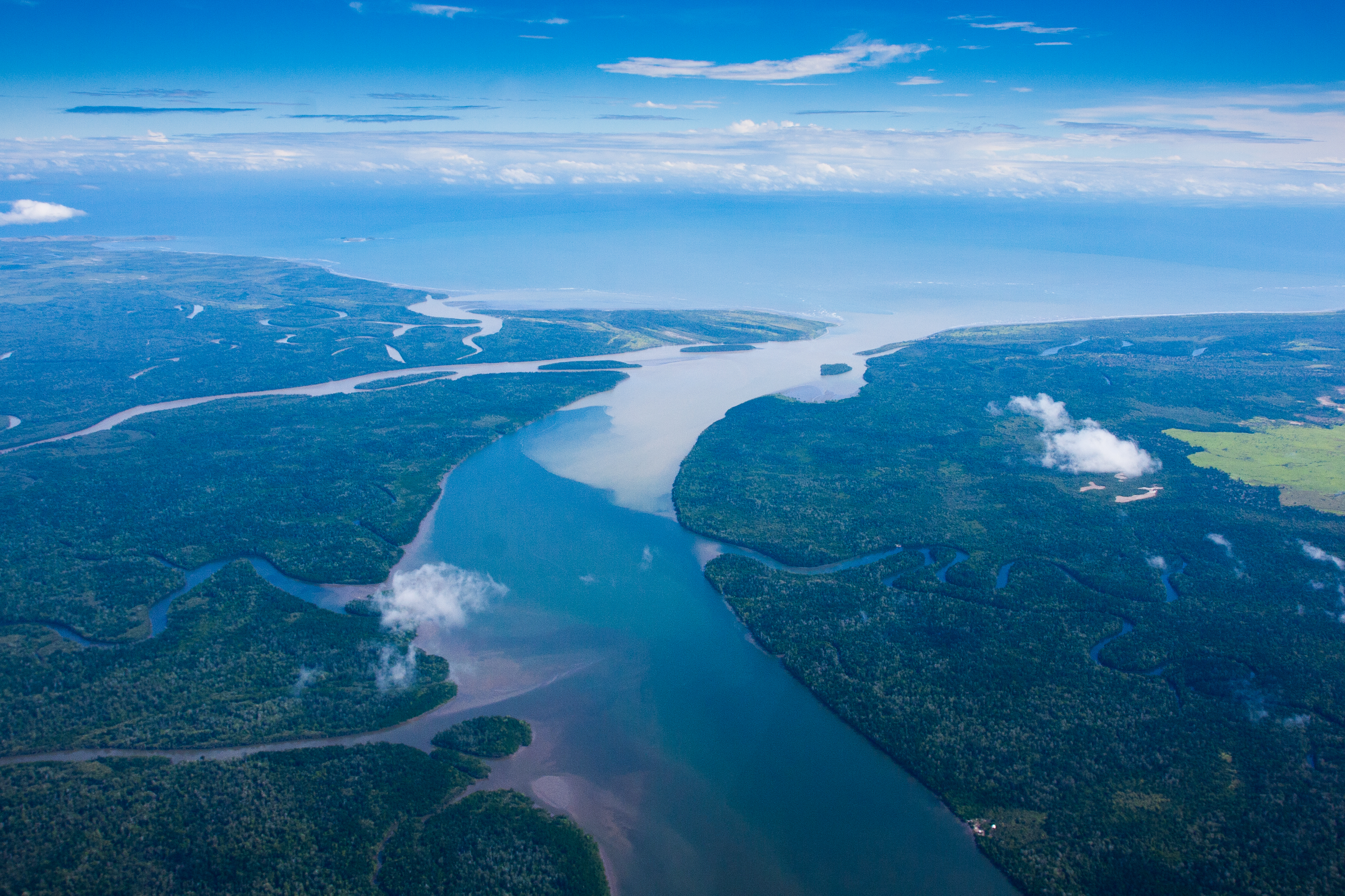 A view from above of a large river and smaller tributaries outside Port Moresby, Papua New Guinea