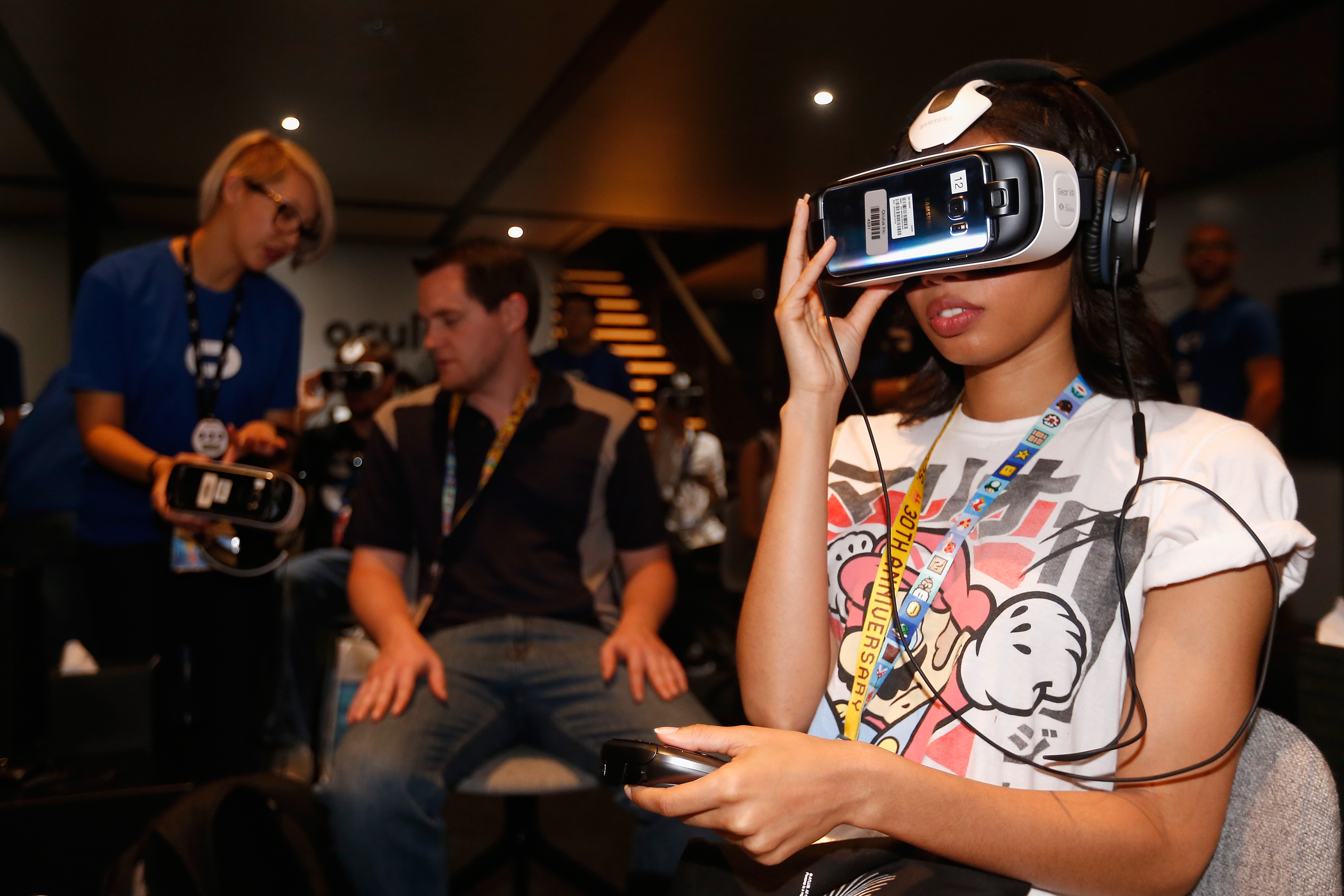 Game enthusiasts test the Samsung Gear VR powered by Oculus at the Annual Gaming Industry Conference E3 at  the Los Angeles Convention Center on June 16, 2015 in Los Angeles, California.