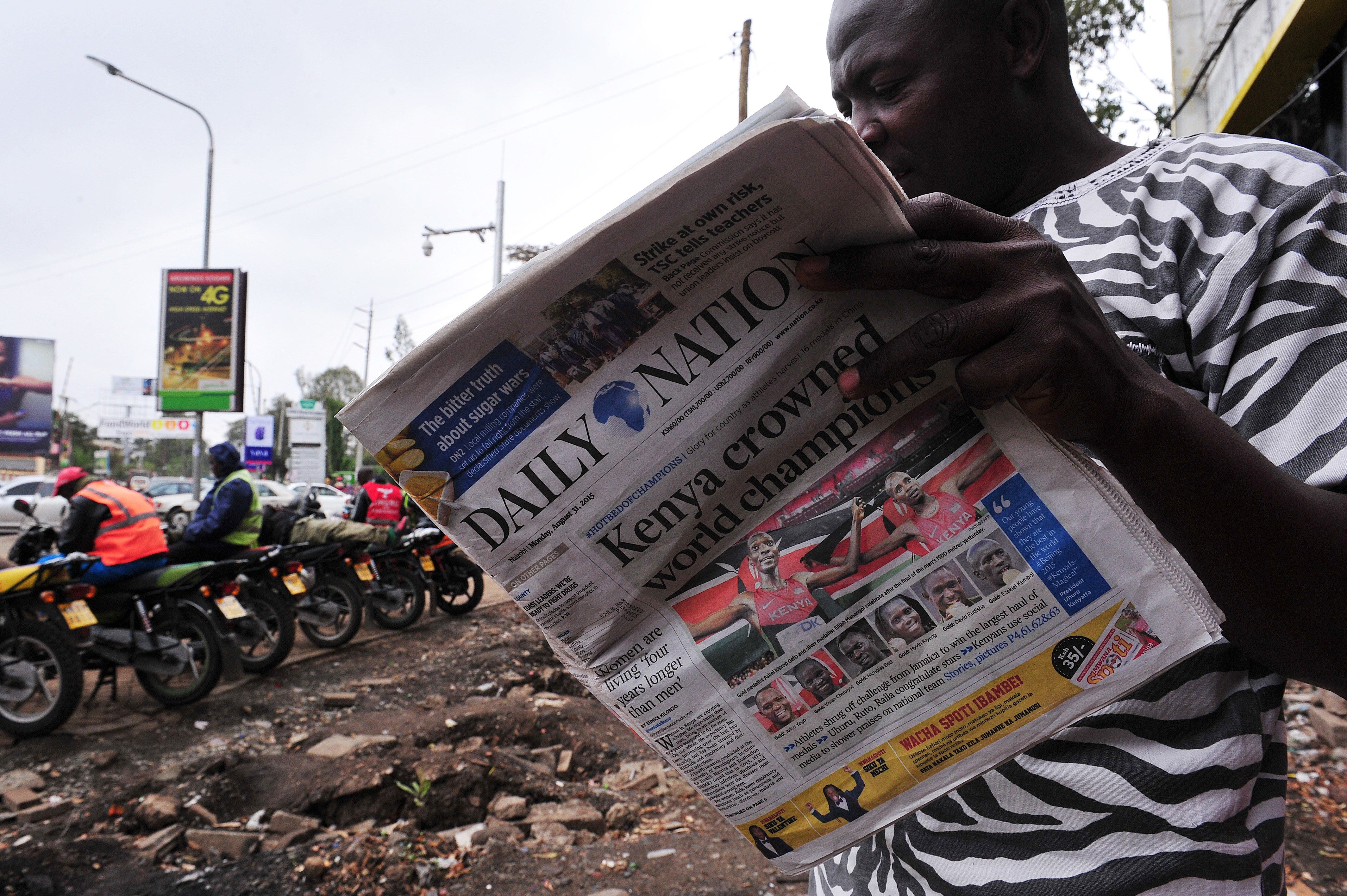 A man reads Kenyan local daily Daily Nation in Nairobi on August 31, 2015.