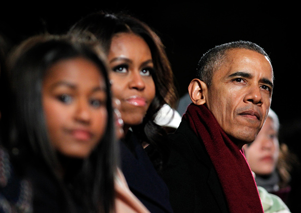 First Lady Michelle Obama, center, and U.S. President Barack Obama attend the 93rd Annual National Christmas Tree Lighting at the Ellipse on Dec. 3, 2015, in Washington, D.C.