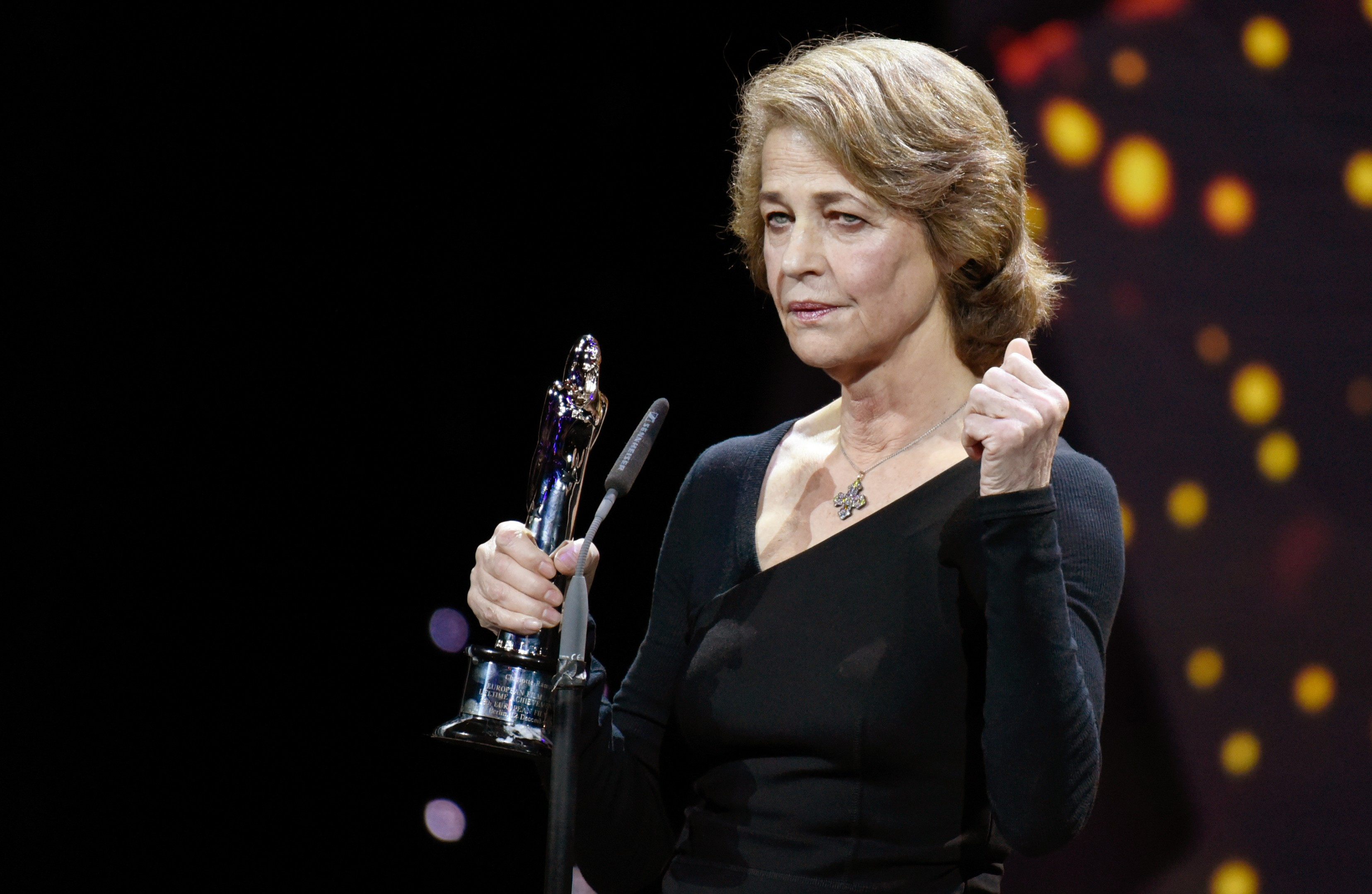 British actress Charlotte Rampling holds her Lifetime Achievement Award during the 28th European Film Award ceremony in Berlin on December 12, 2015.