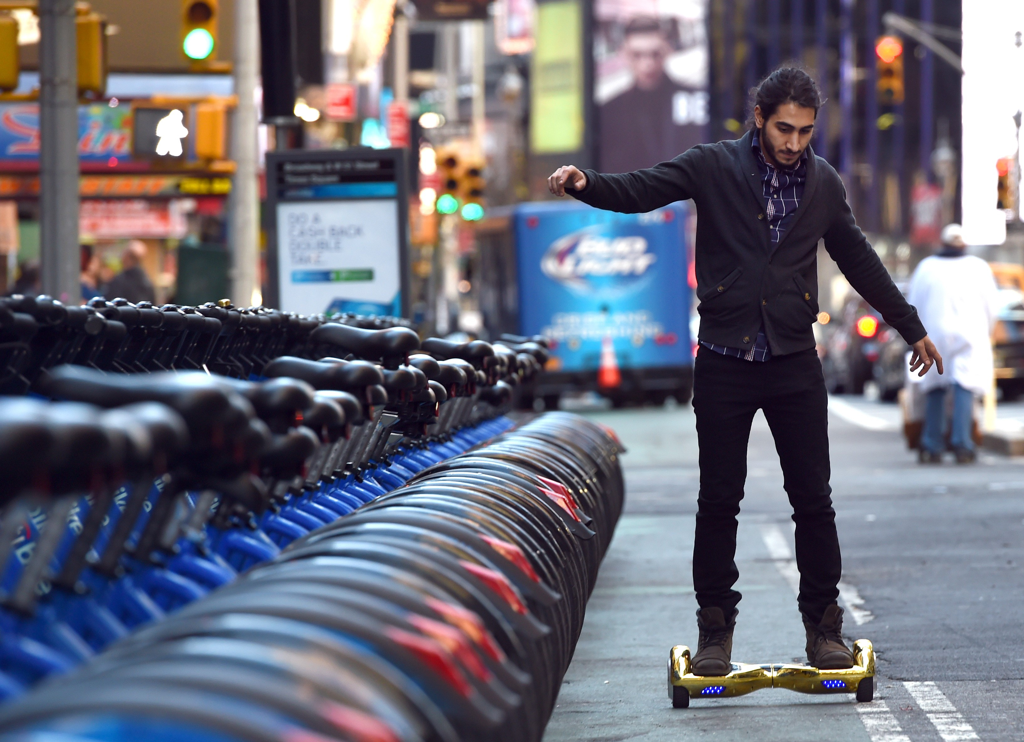 Whizboard Store manager 'Mor Loud'  demonstrates the Hoverboard on Broadway in Times Square December 15, 2015.