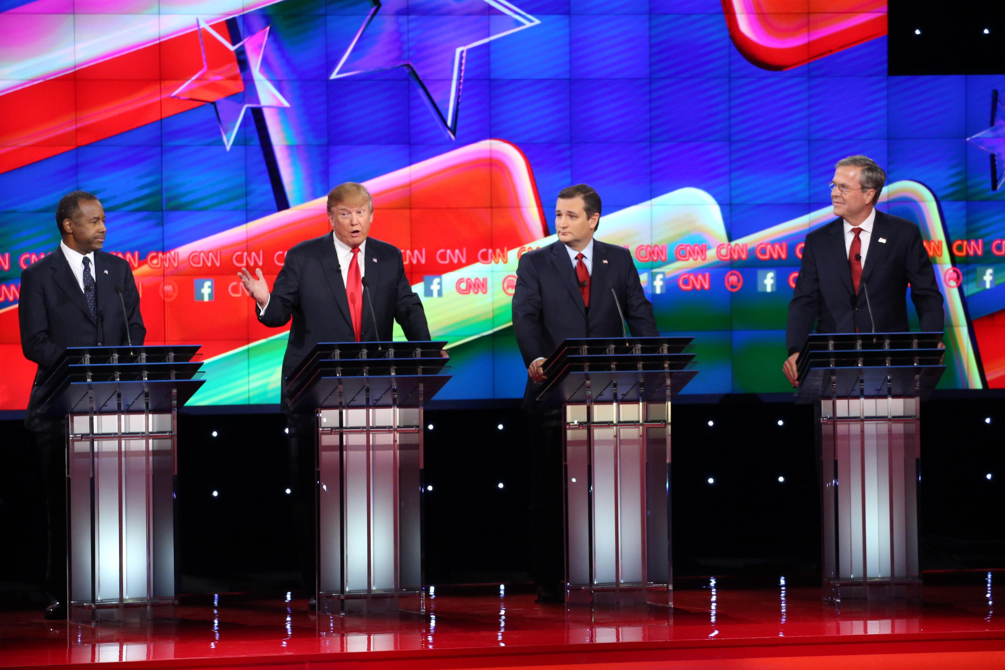 Donald Trump, speaks as 2016 Republican presidential candidates Ben Carson, Senator Ted Cruz and Jeb Bush, listen during the Republican presidential candidate debate at The Venetian in Las Vegas on Dec. 15, 2015.