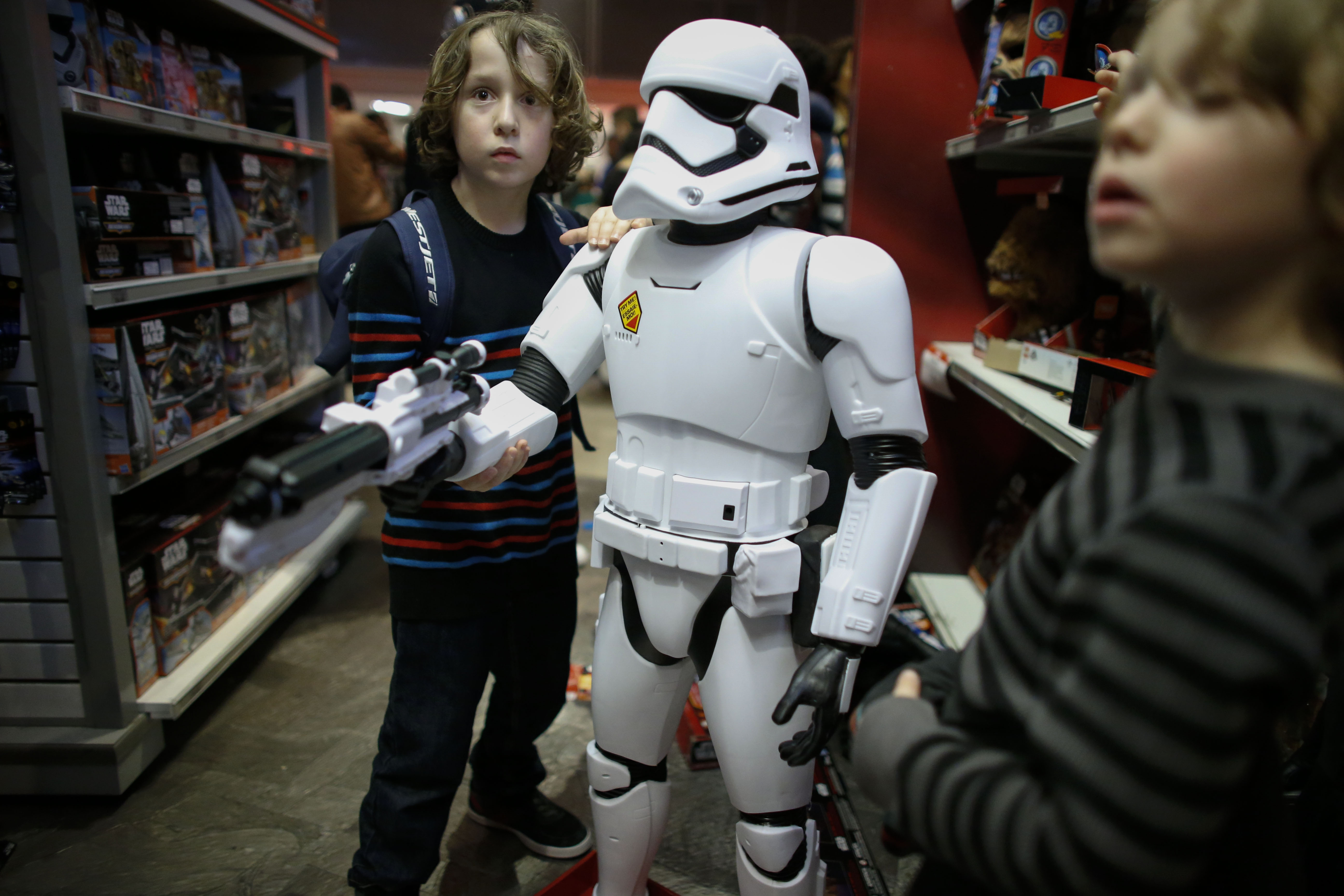 Boys play with a Stormtrooper toy from Star Wars at a Toys R Us store on December 24, 2015 in New York City.