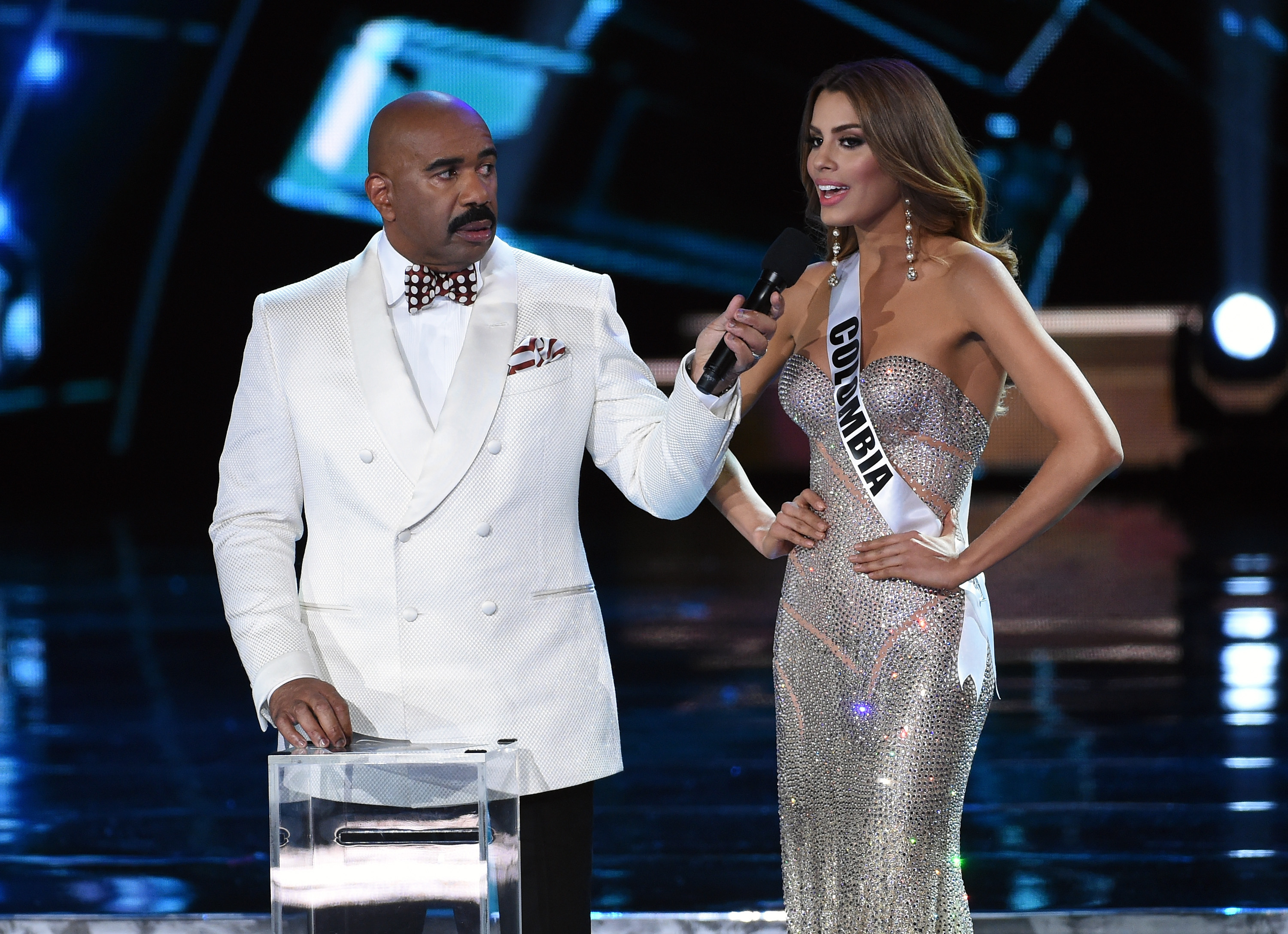 Host Steve Harvey listens as Miss Colombia 2015, Ariadna Gutierrez Arevalo, answers a question during the interview portion of the 2015 Miss Universe Pageant on Dec. 20, 2015.
