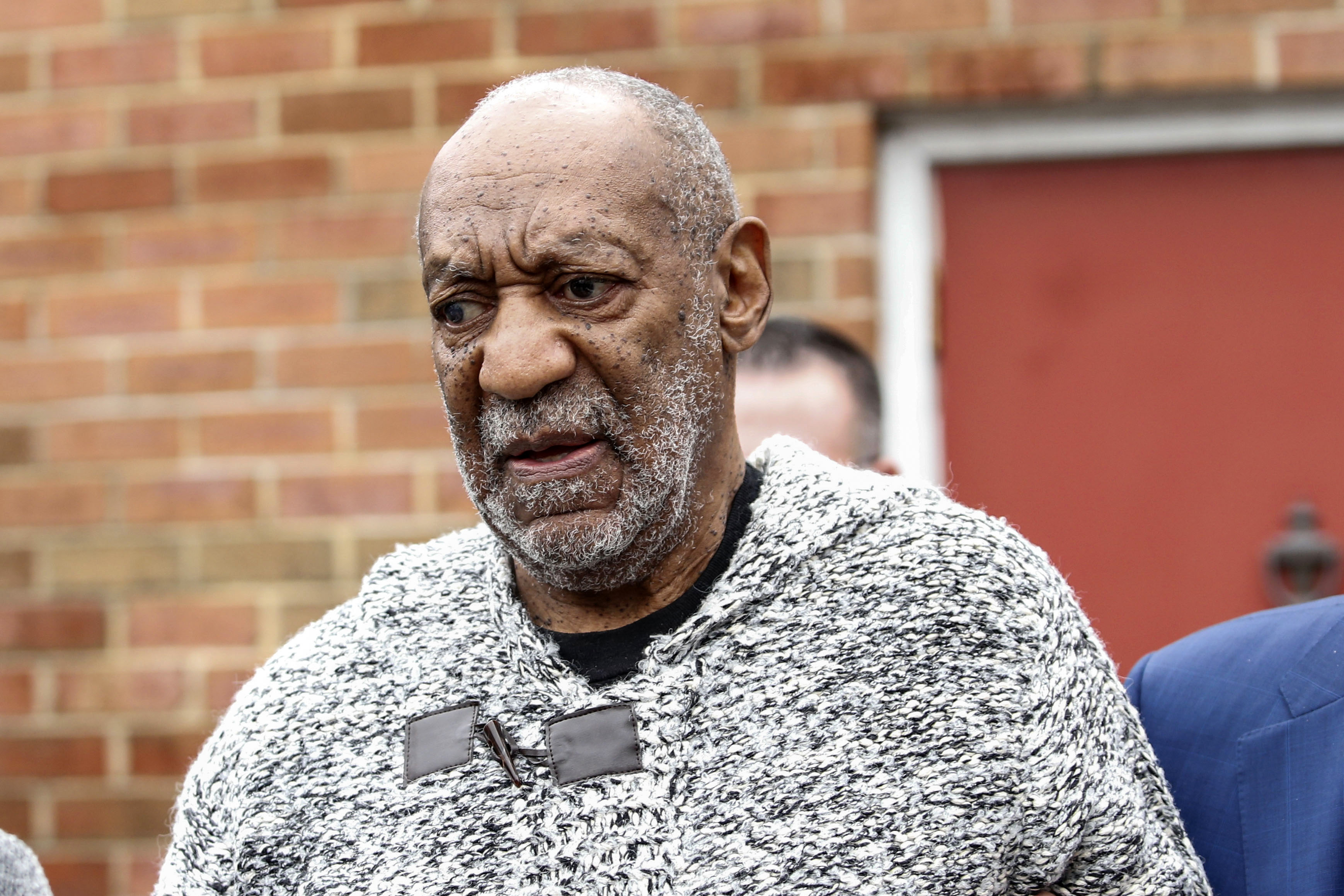 Comedian Bill Cosby leaves Dec. 30, 2015 the Court House in Elkins Park, Pennsylvania after arraignment on charges of aggravated indecent assault.