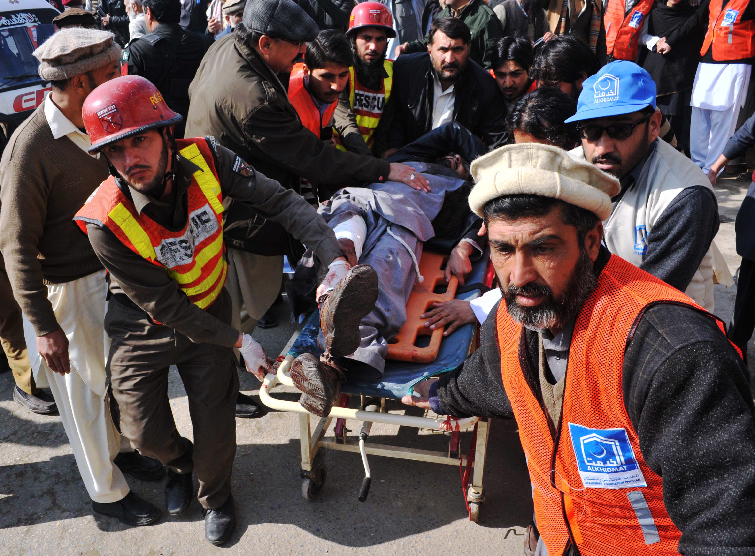 Pakistani rescuers shift an injured man to a hospital following an attack by gunmen in the Bacha Khan university in Charsadda, about 50 kilometres from Peshawar, on Jan. 20, 2016.