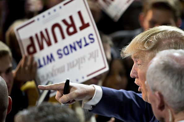 Donald Trump, president and chief executive of Trump Organization Inc. and 2016 Republican presidential candidate, right, greets attendees during a campaign rally in Muscatine, Iowa, U.S., on Sunday, Jan. 24, 2016. Bloomberg—Bloomberg via Getty Images