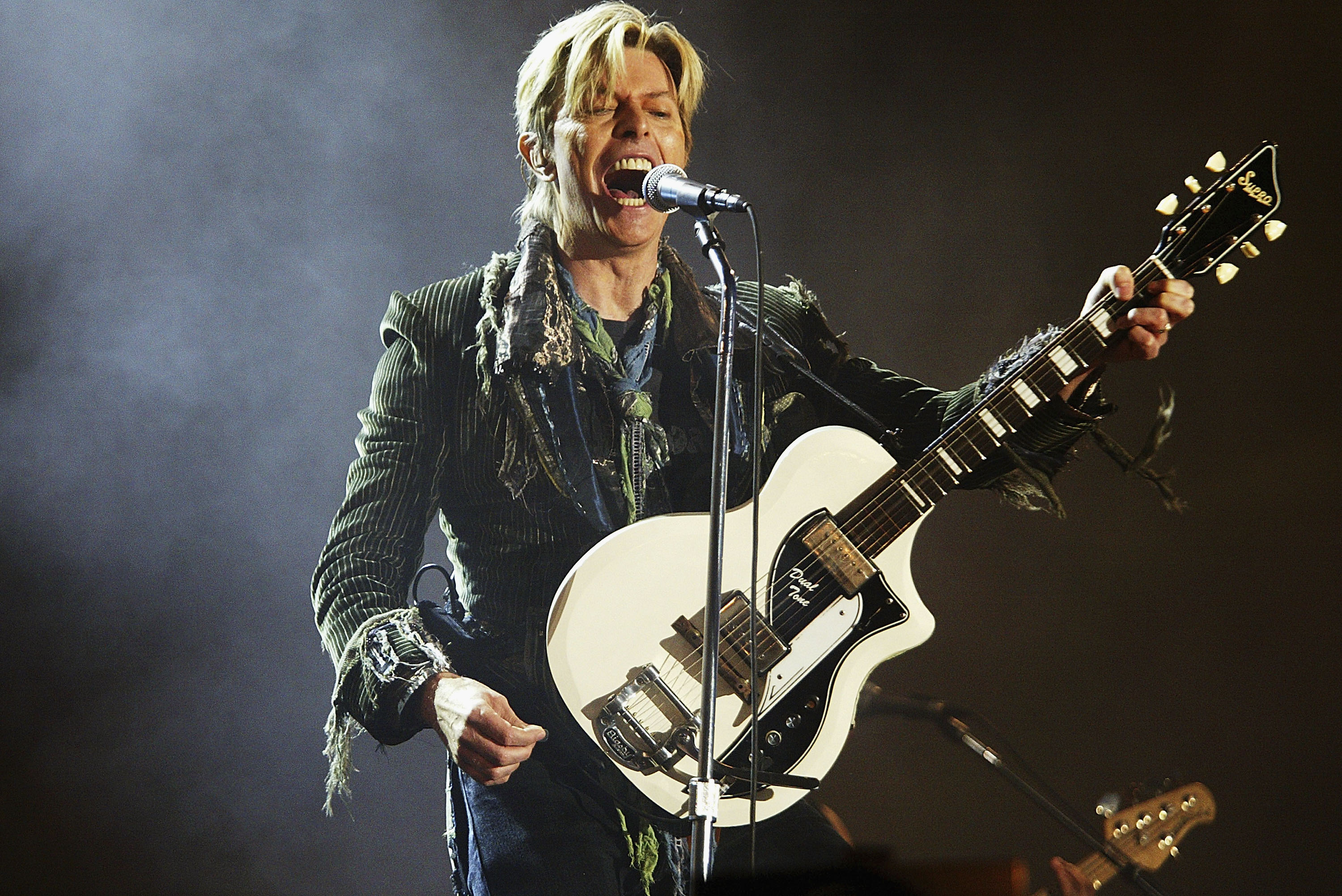 David Bowie performs on stage on the third and final day of  The Nokia Isle of Wight Festival 2004 , on June 13, 2004 in Newport, UK.