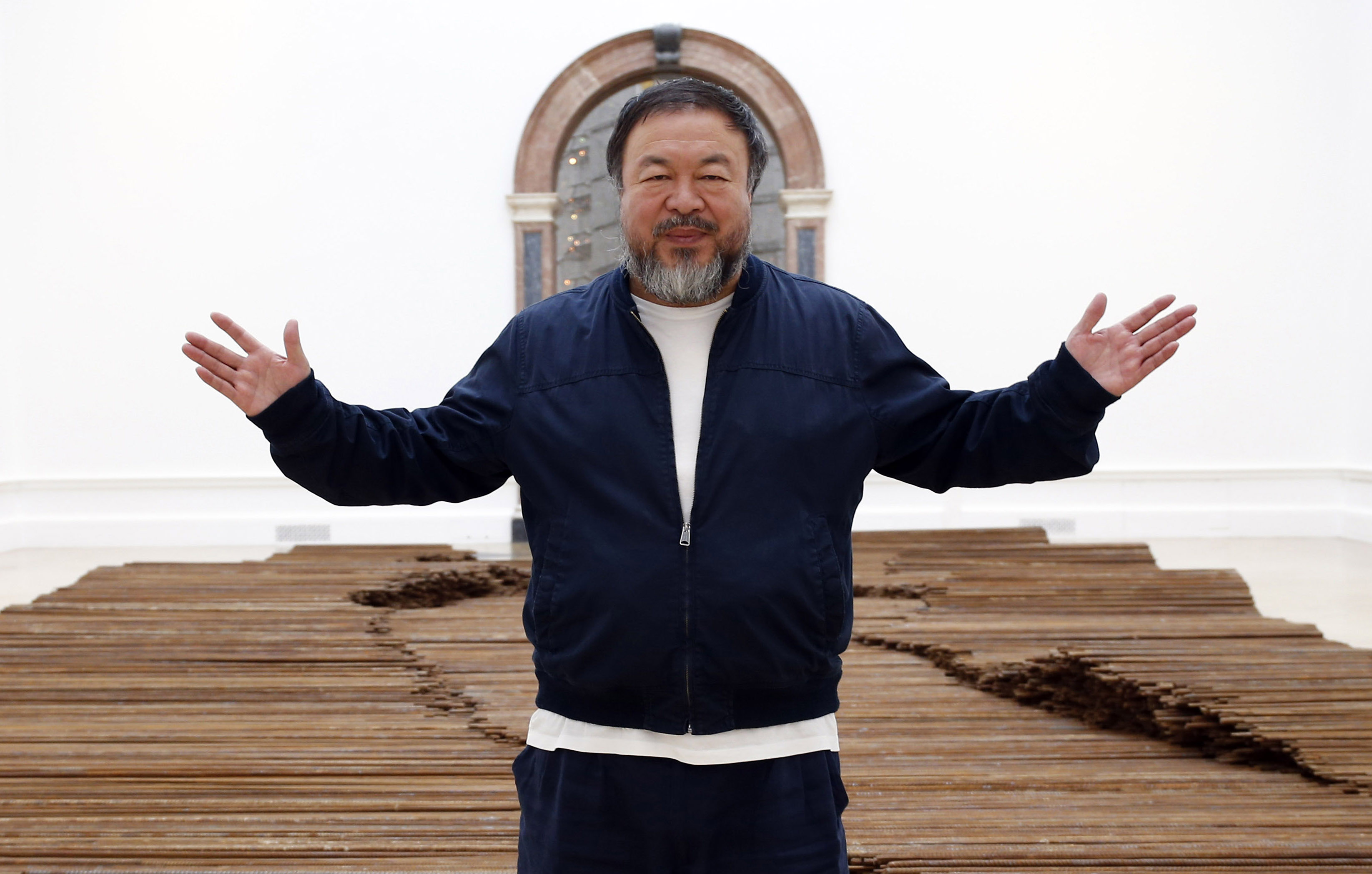 Ai Weiwei stands with his sculpture 'Straight' as he previews works from his landmark art exhibition in London on Sept. 15, 2015.