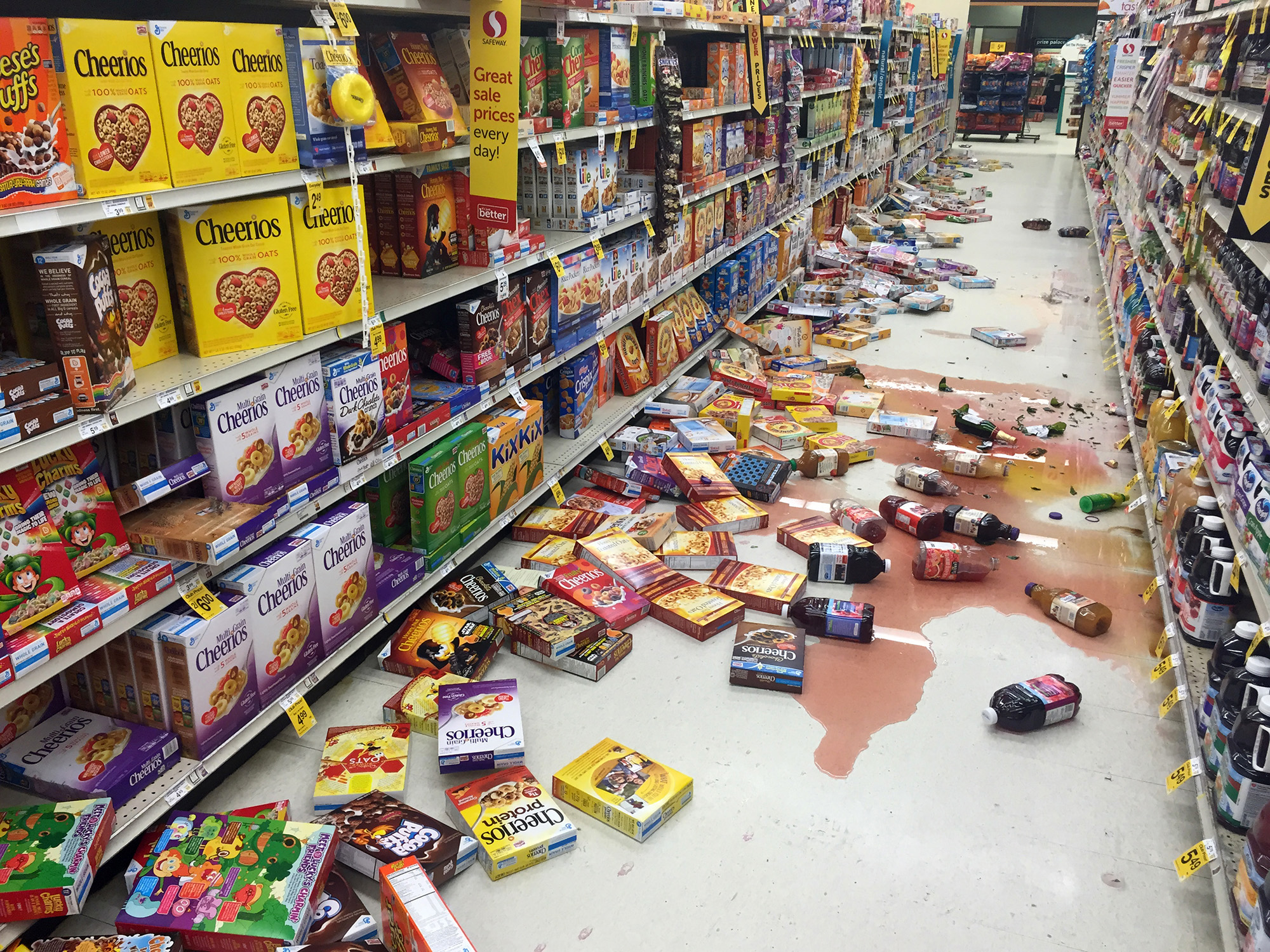 Boxes of cereal and bottles of juice lie on the floor of a Safeway grocery store following an earthquake on the Kenai Peninsula in Alaska on Jan. 24, 2016.