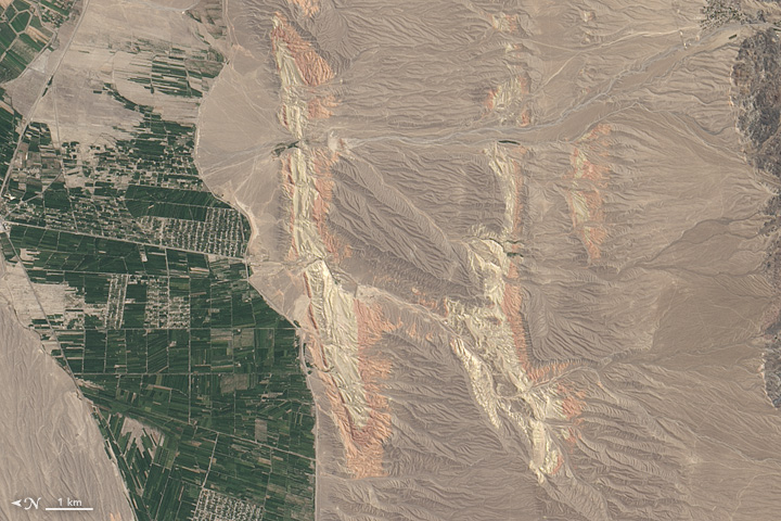 H: The Operational Land Imager on Landsat 8 acquired this image of rivers running through colorful ridges in southwestern Kyrgyzstan on Aug. 30, 2014.