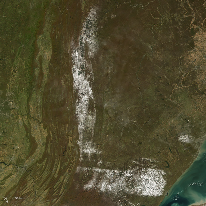 L: The Moderate Resolution Imaging Spectroradiometer (MODIS) on the Aqua satellite captured this image of snow across the northeastern United States on Oct. 30, 2008.