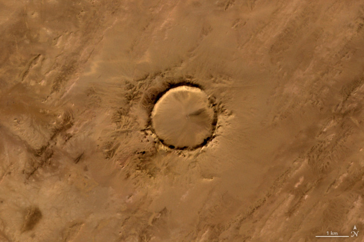 O: The Advanced Spaceborne Thermal Emission and Reflection Radiometer (ASTER) on the Terra satellite captured this image of Tenoumer meteorite crater in Mauritania on Jan. 24, 2008.