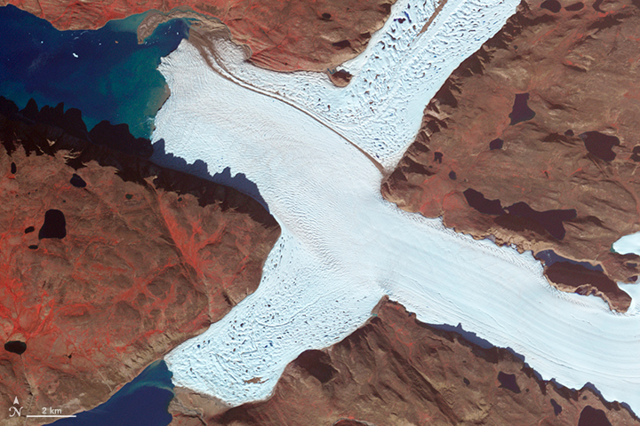 X: The Advanced Spaceborne Thermal Emission and Reflection Radiometer (ASTER) on NASA's Terra satellite captured this false-color image of the northwest corner of Leidy Glacier in Greenland on Aug. 7, 2012.