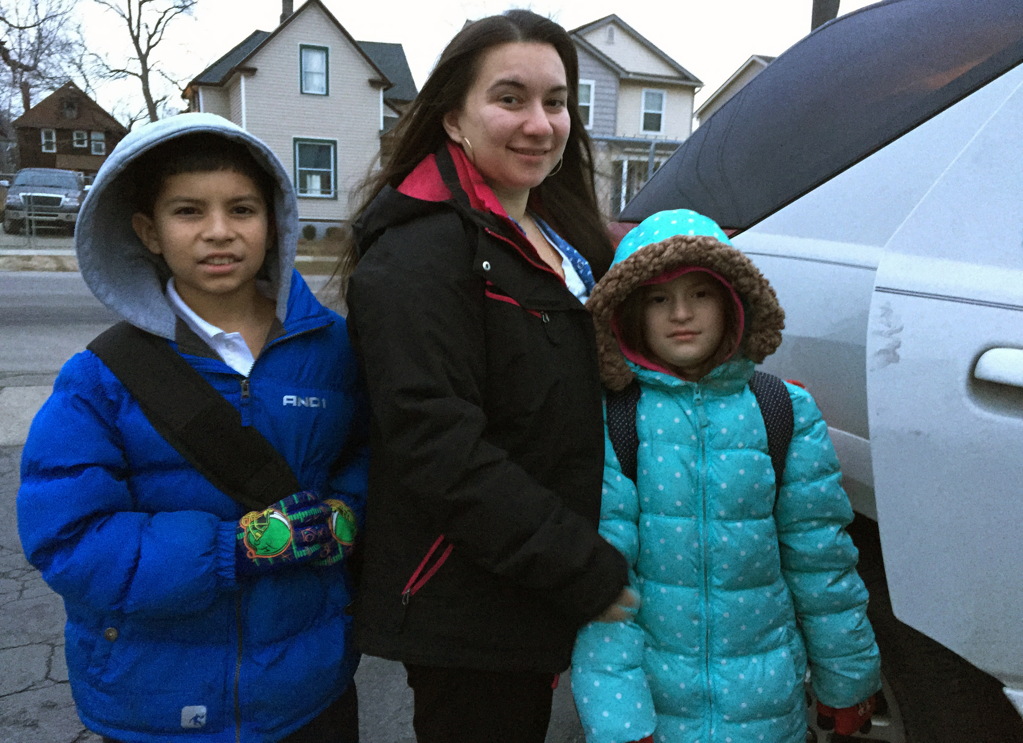 Detroit Public School teacher Alise Anaya with her children Victor, 10, and Analise, 8, before they head to a public school in Southwest Detroit from their home in a nearby suburb.