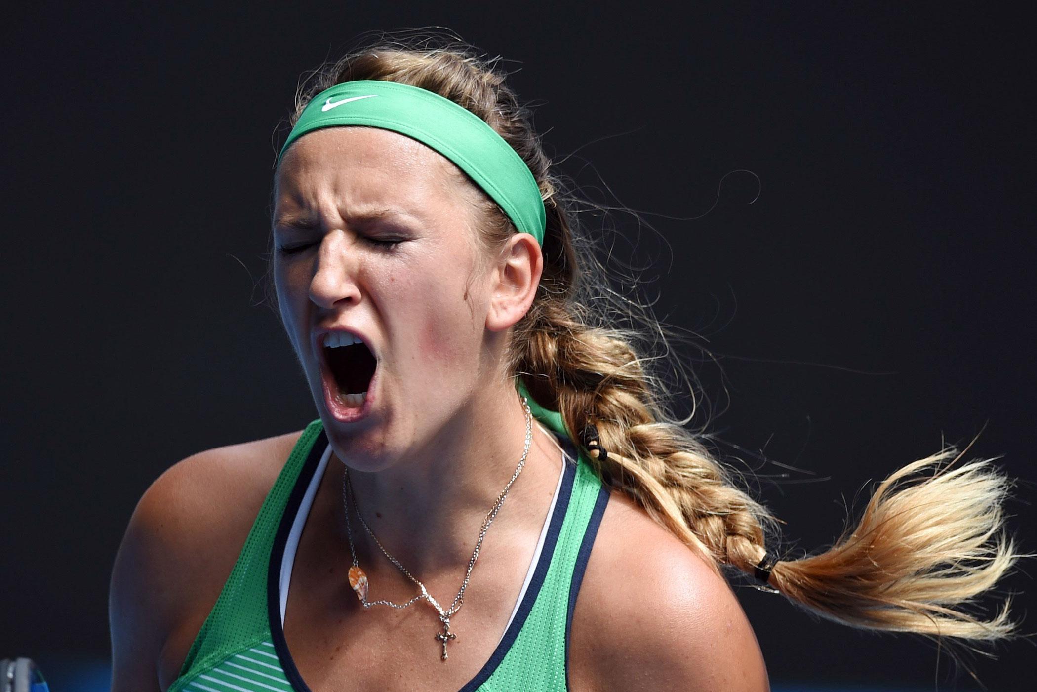 Belarus's Victoria Azarenka celebrates a point during her women's singles match against Germany's Angelique Kerber on Jan. 27, 2016.