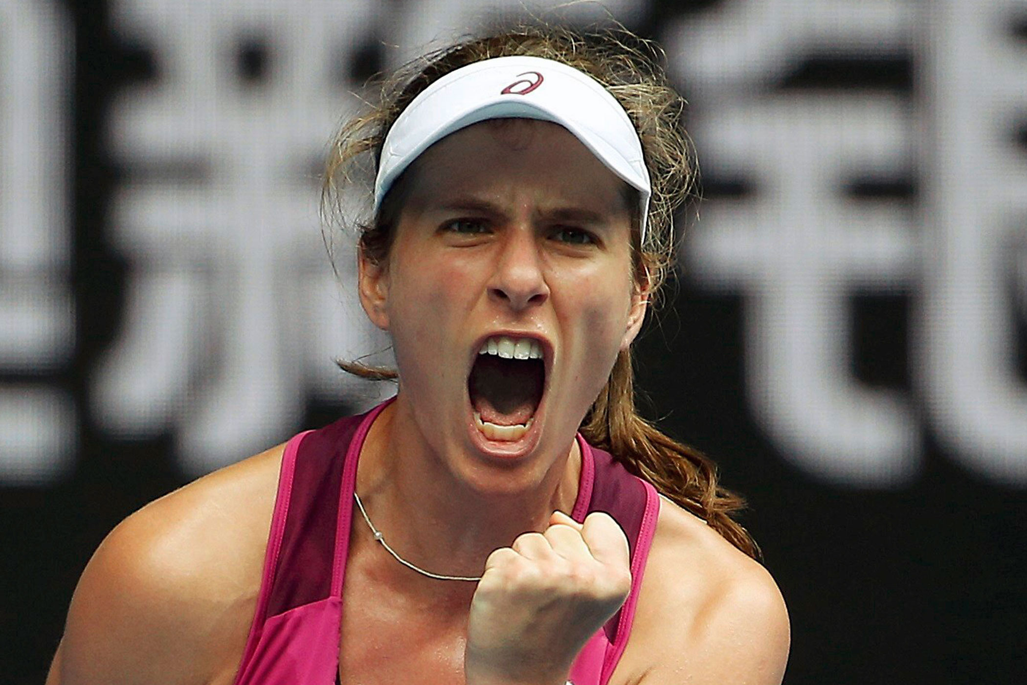Britain's Johanna Konta celebrates winning the first in her quarter-final match against China's Zhang Shuai on Jan. 27.