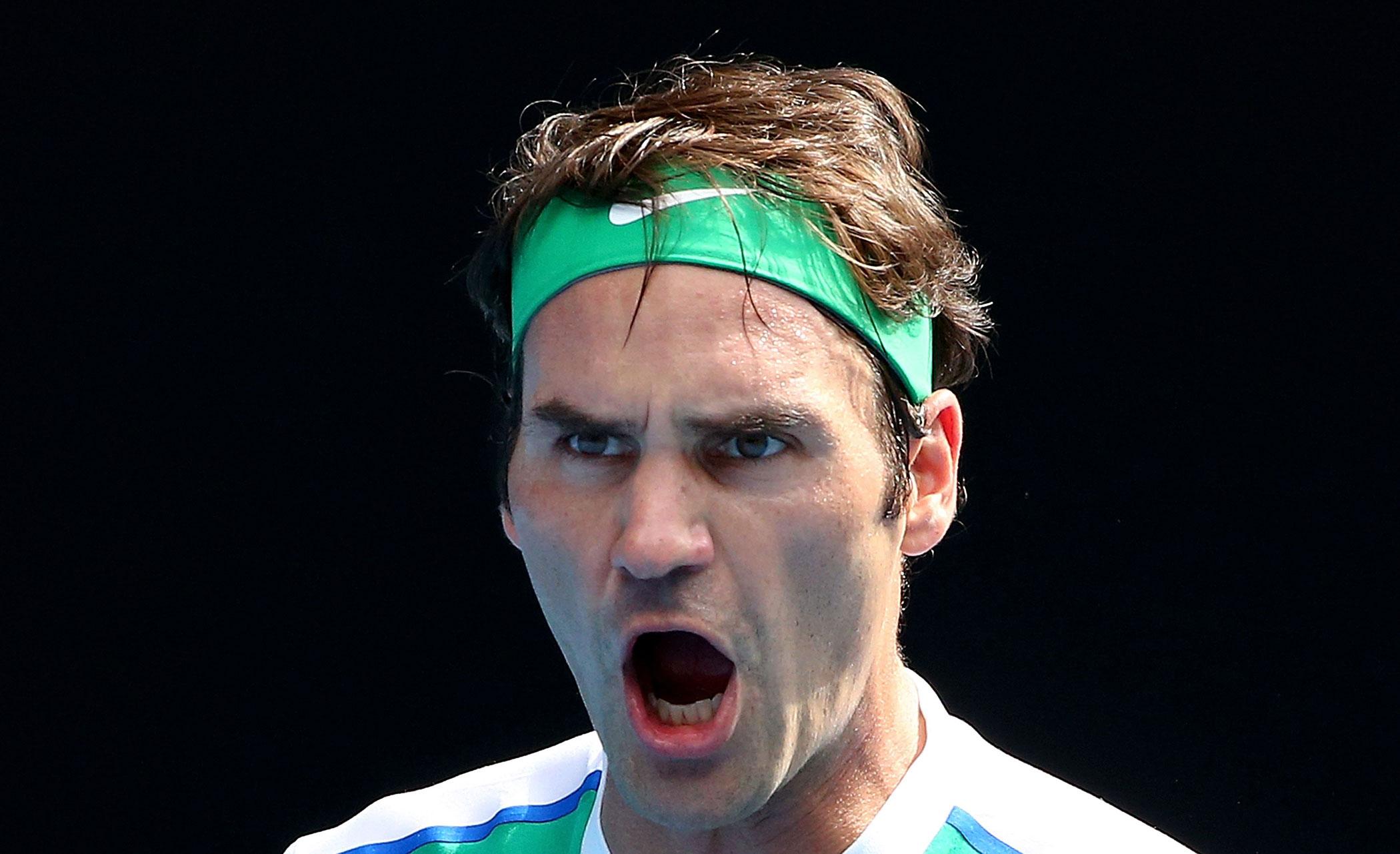 Switzerland's Roger Federer celebrates during his quarter final match against Czech Republic's Tomas Berdych on Jan. 26.