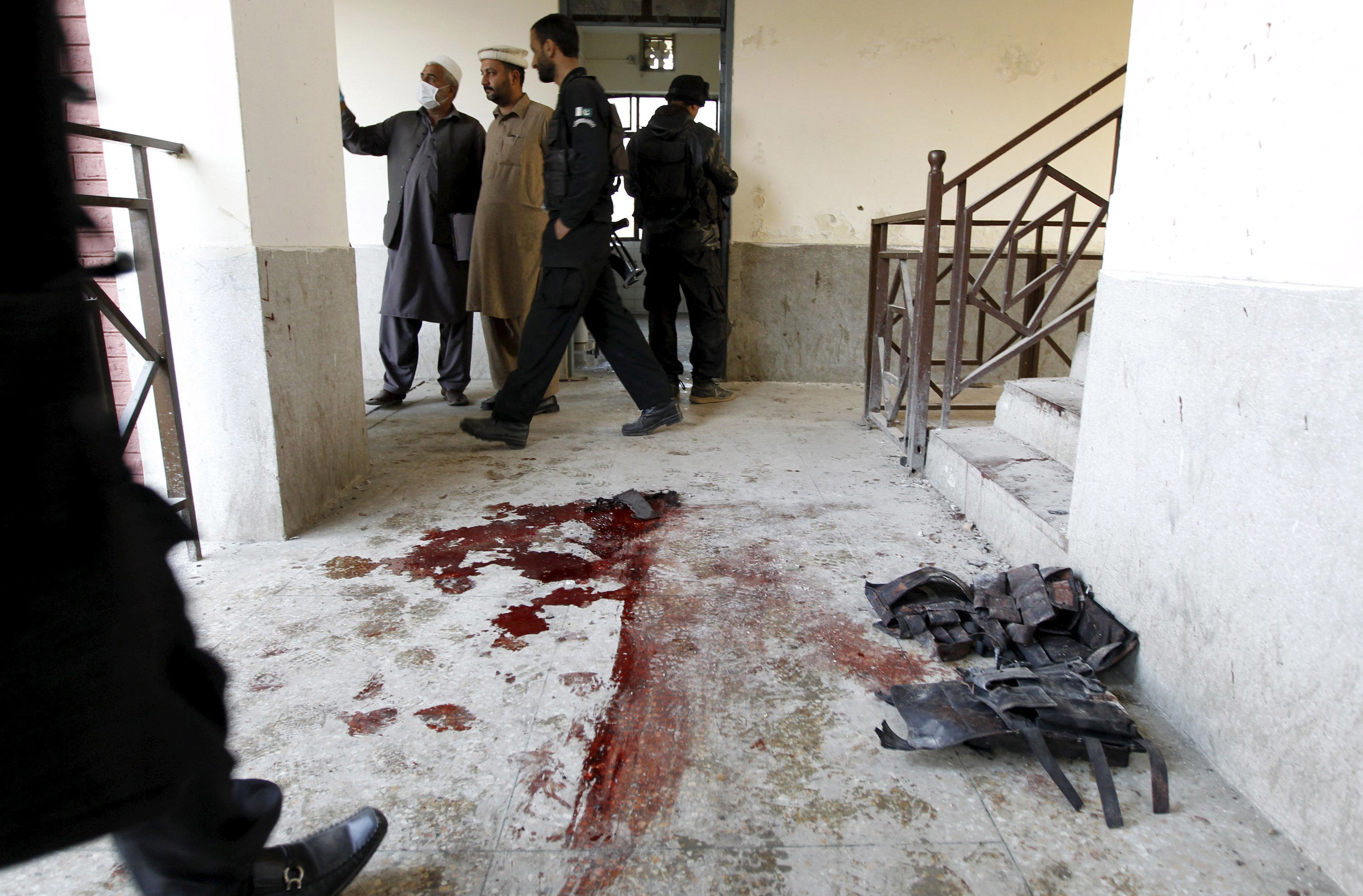 Blood stains and flak jackets used by attackers remain in the hallway of a dormitory where a Taliban attack took place at Bacha Khan University in Charsadda, Pakistan, on Jan. 20, 2016.
