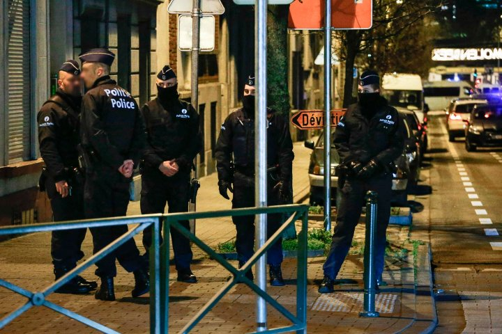 Belgian police conduct searches linked to the Paris attacks in Molenbeek, Brussels, on Dec.30