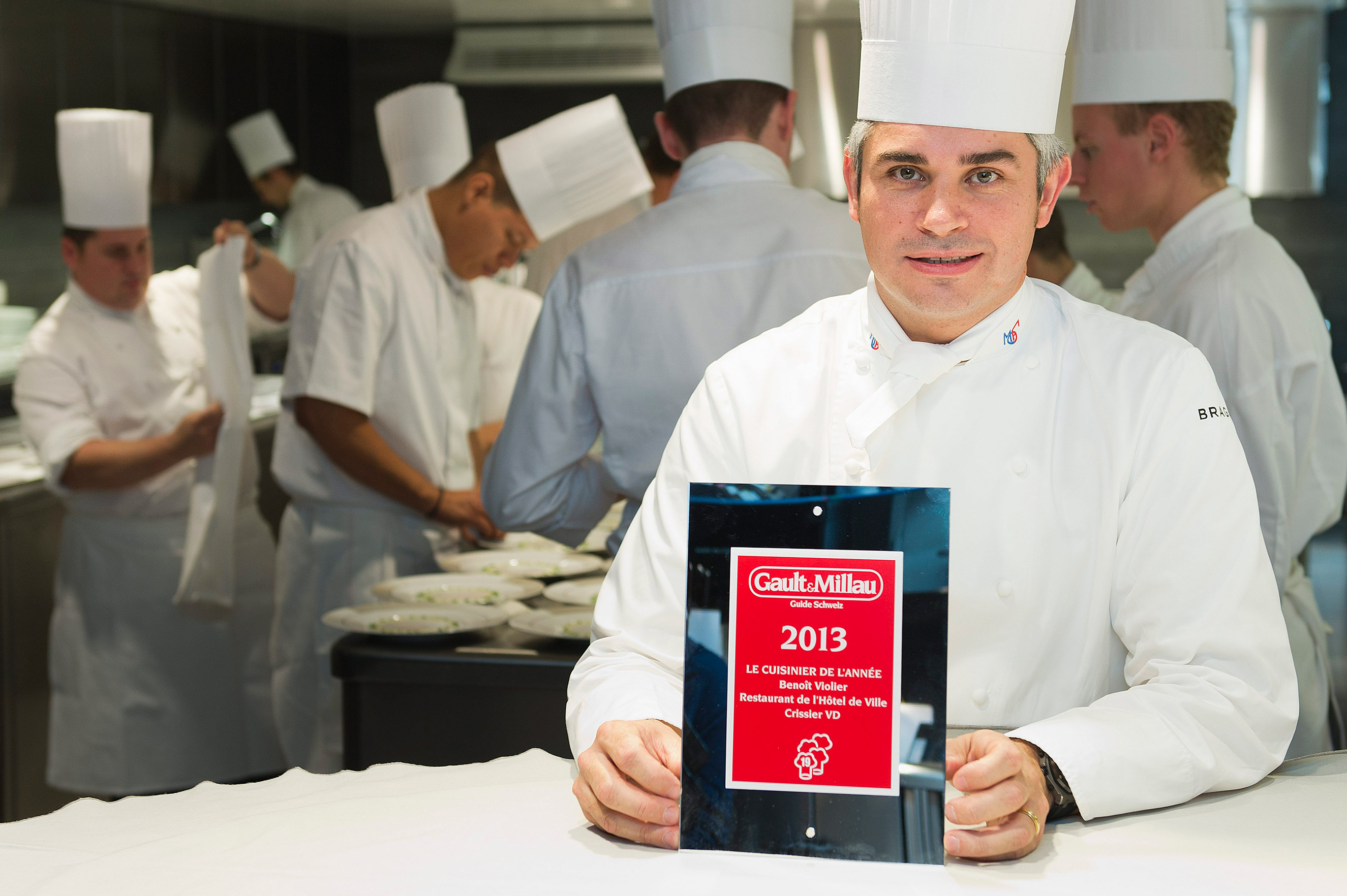 Benoit Violier poses with the certificate as Chef of the Year in his kitchen in the Hotel de Ville in Crissier, Switzerland, Oct. 8, 2012.