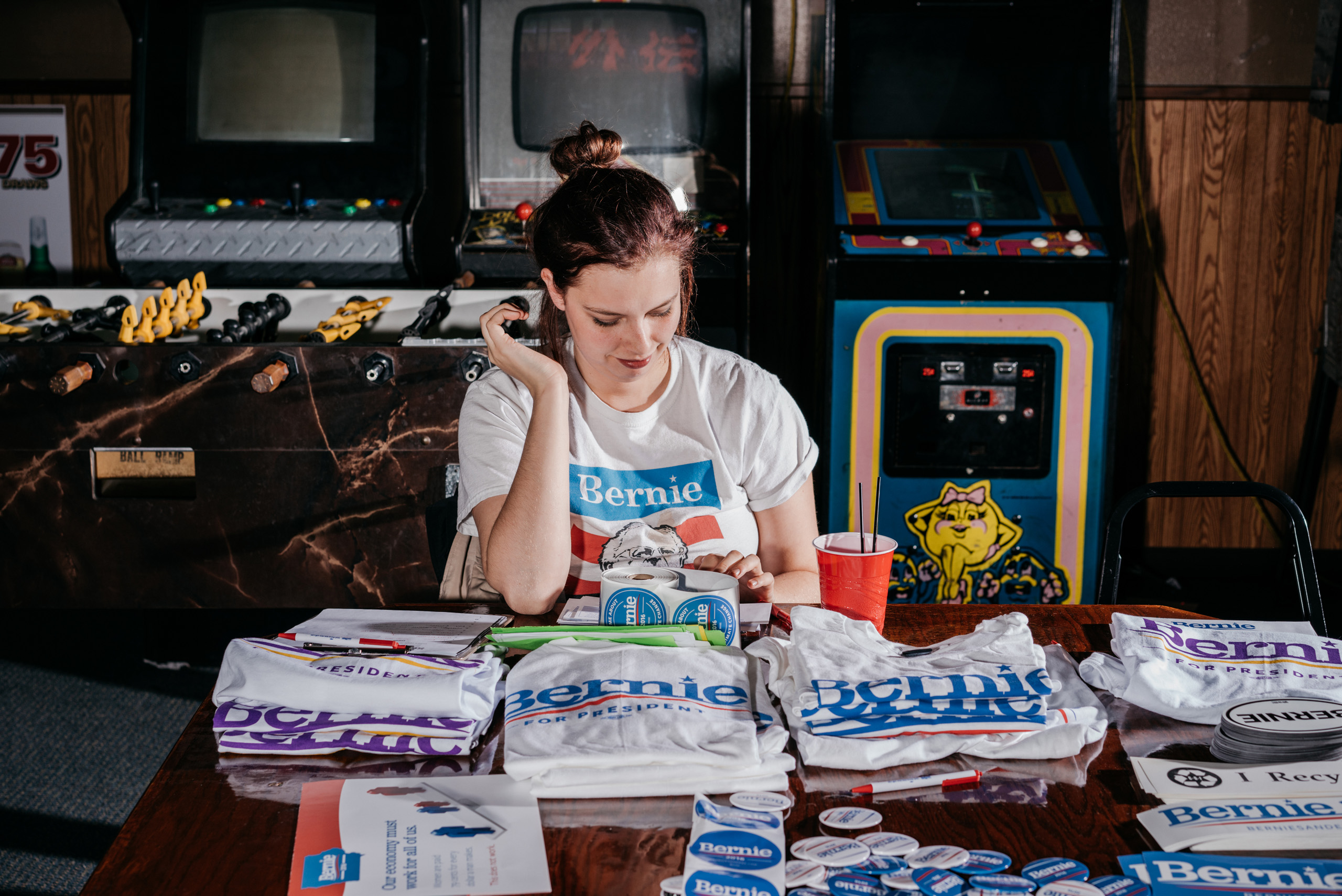 Tori Hall sells T-shirts  at a Bernie Sanders fundraiser billed as  Waterloo Shred for Bernie: Part 2  at The Wedge bar in Waterloo, IA, Saturday January 23, 2016.
