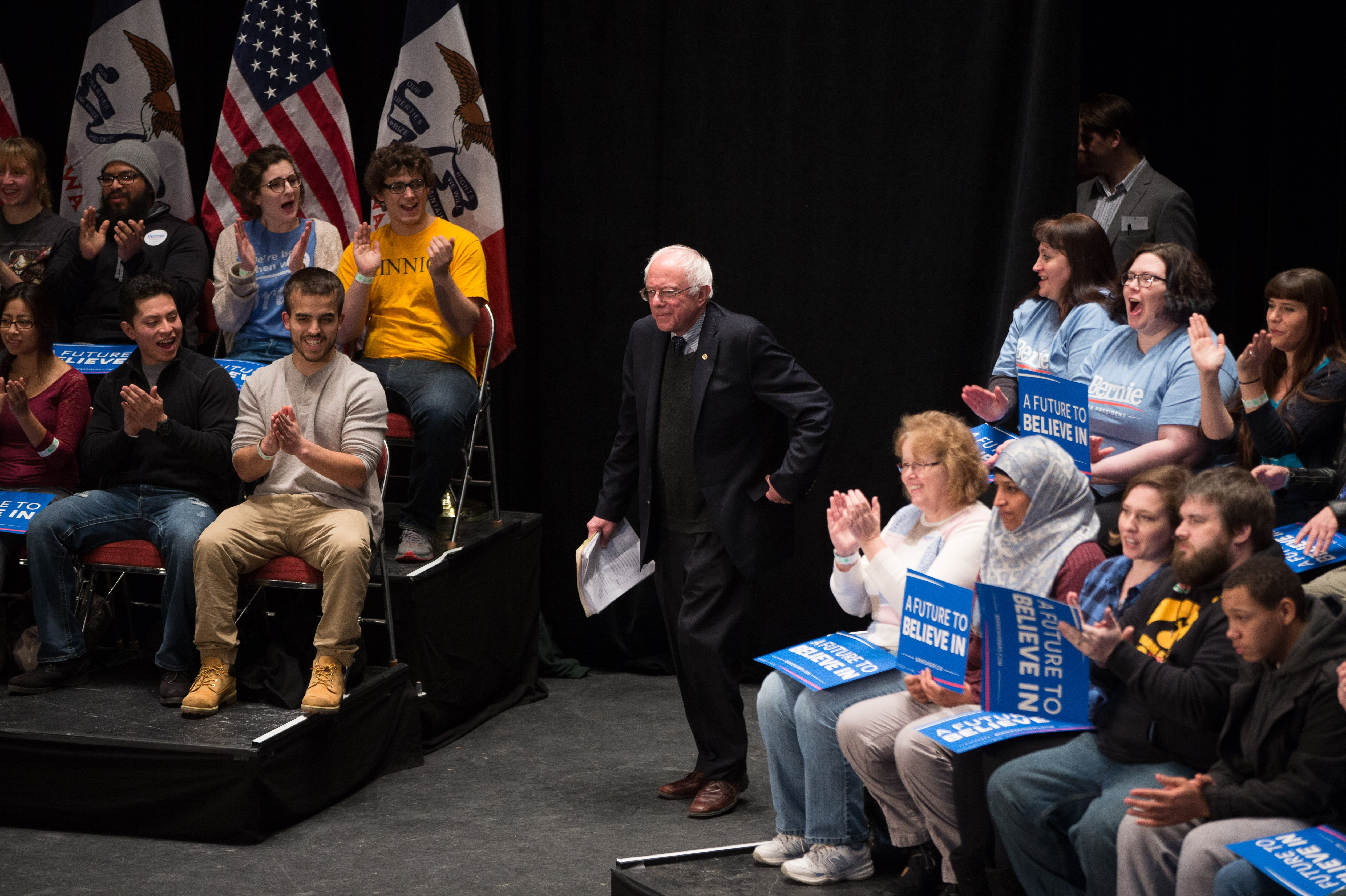 Democratic presidential candidate Sen. Bernie Sanders, I-Vt., takes the stage to speak at a town hall at the Orpheum Theater in Sioux City, Iowa on Jan. 19, 2016.