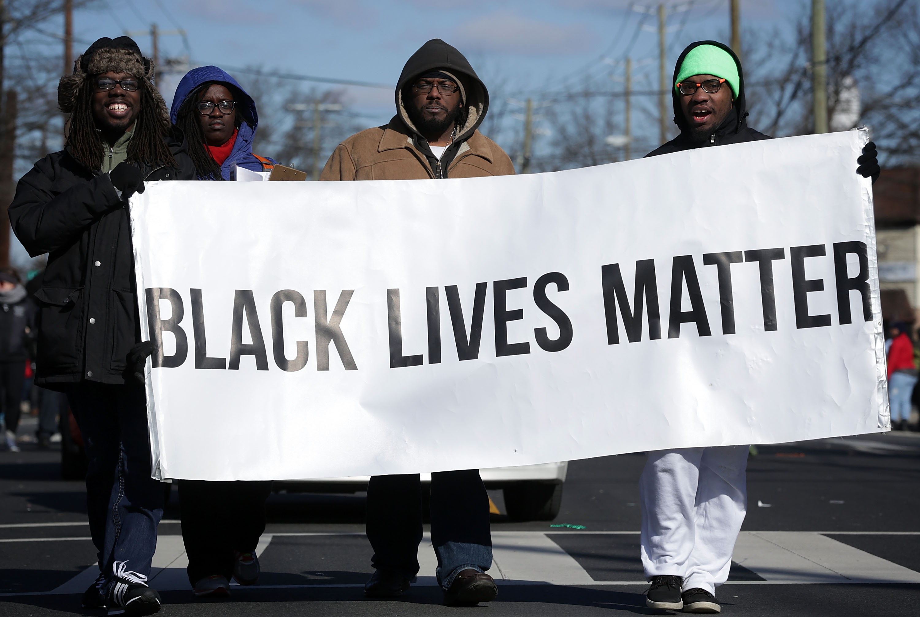 Members of Black Lives Matter DMV participate in the annual Martin Luther King Holiday Peace Walk and Parade January 18, 2016 in Washington, DC.