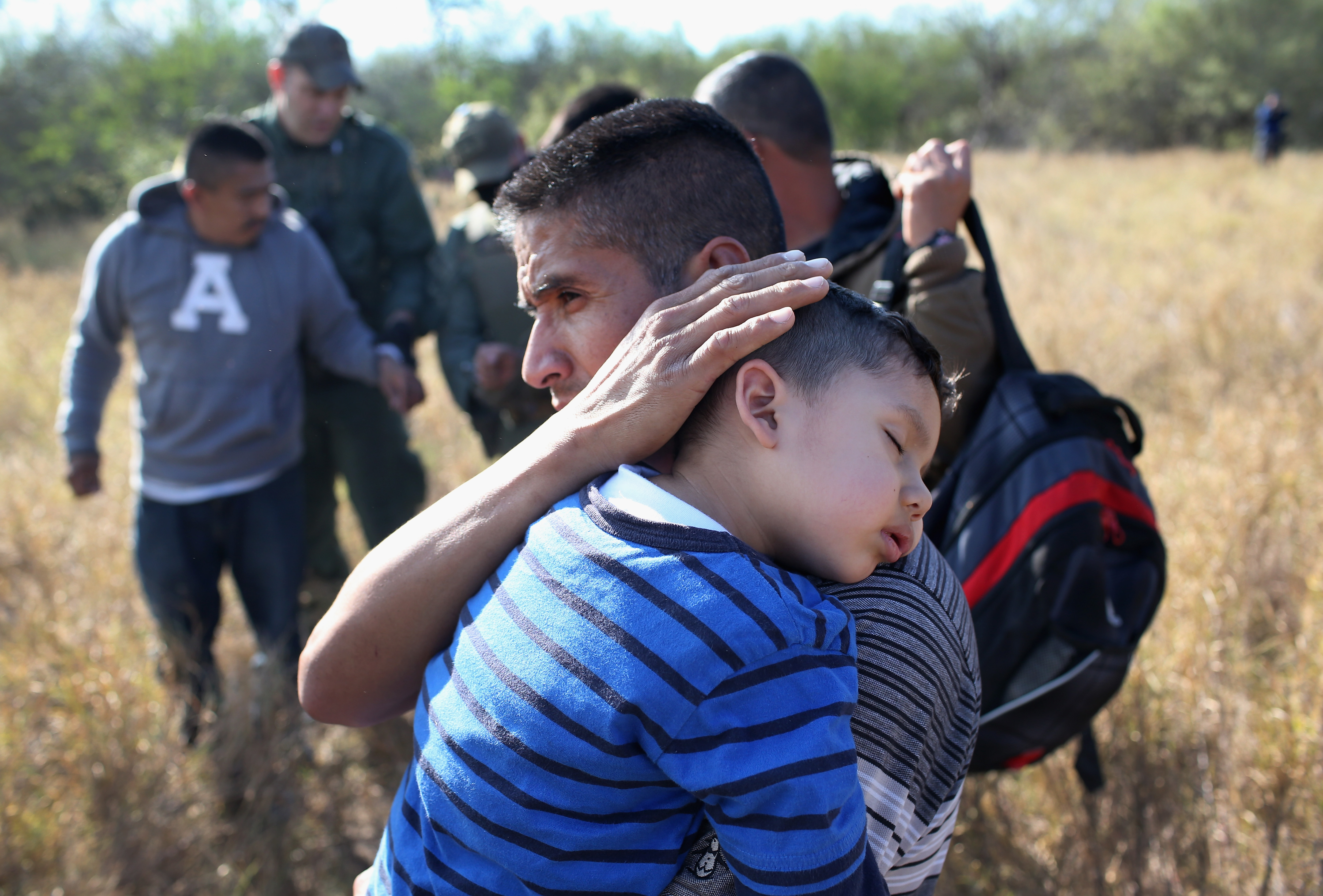 A father and his son after being detained by Border Patrol agents on Dec. 7, 2015 near Rio Grande City, Texas.