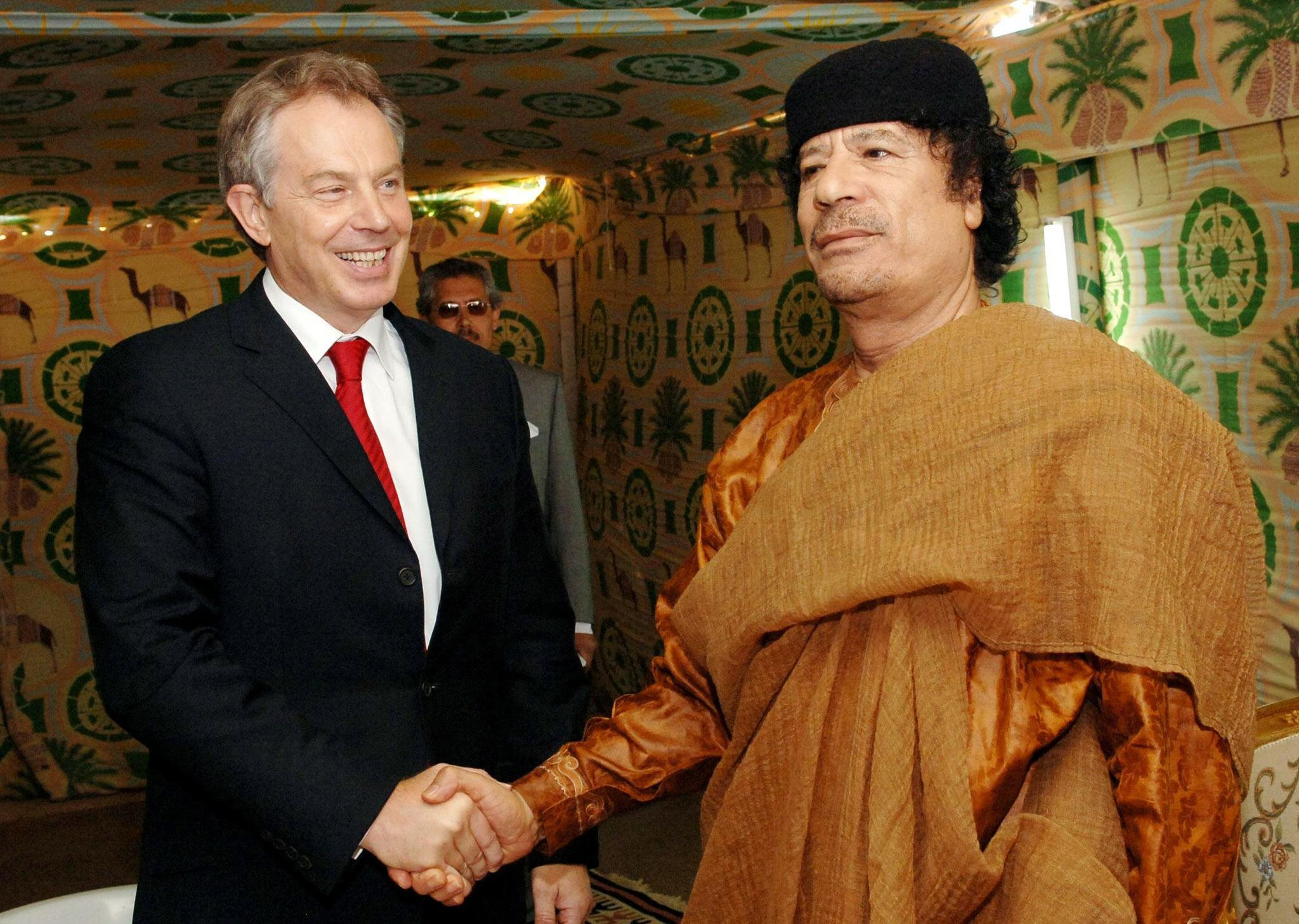 Prime Minister Tony Blair meeting Libyan leader Colonel Muammar Gaddafi at his desert base outside Sirte, south of Tripoli on May 29, 2007.