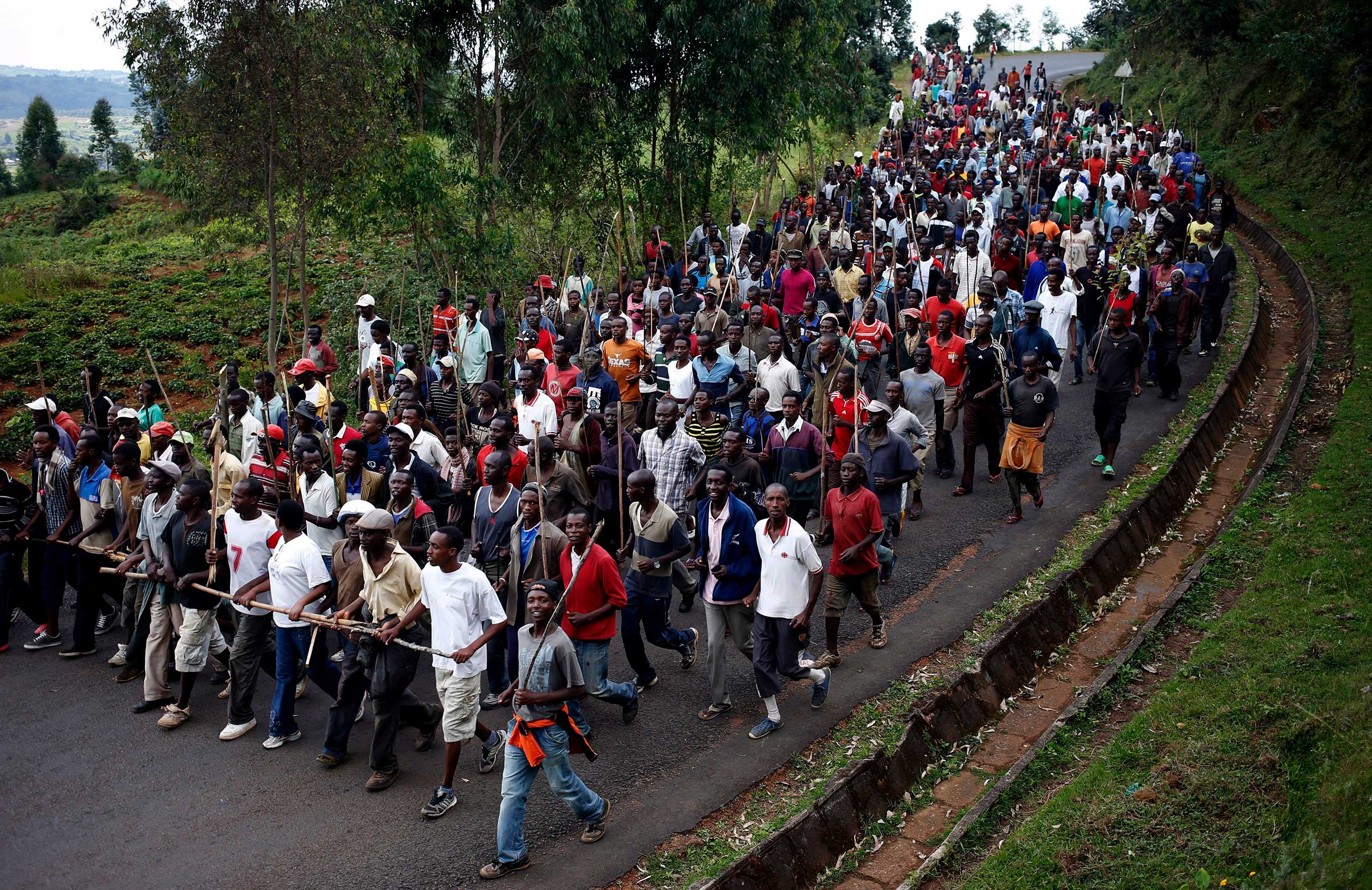 Protesters against President Pierre Nkurunziza and his bid for a third term march towards the town of Ijenda, Burundi, June 3, 2015. The election, resulting in a disputed win for Nkurunziza, was rocked by violence between his supporters and opponents.