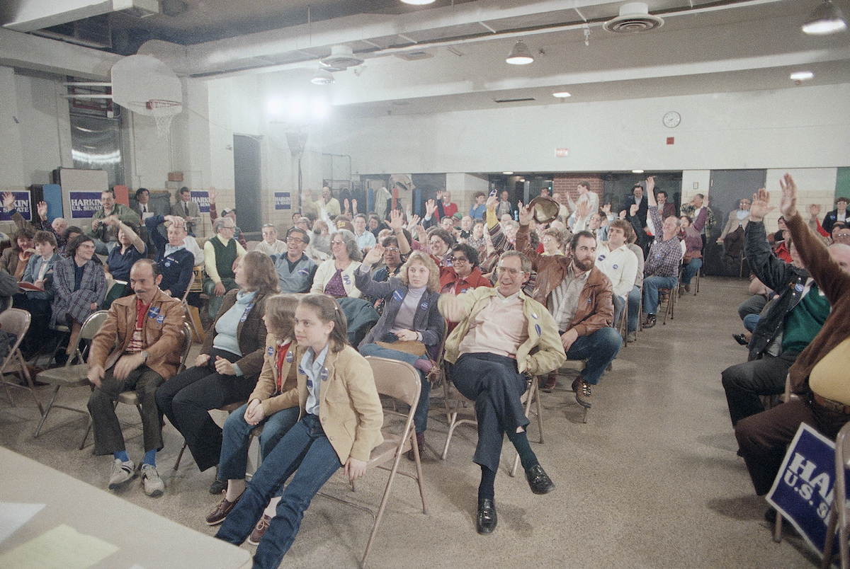Hands go up to vote for former Vice President Walter Mondale Feb. 20, 1984, at a Democratic Precinct Caucus at St. Anthony's Church School in Des  Moines.