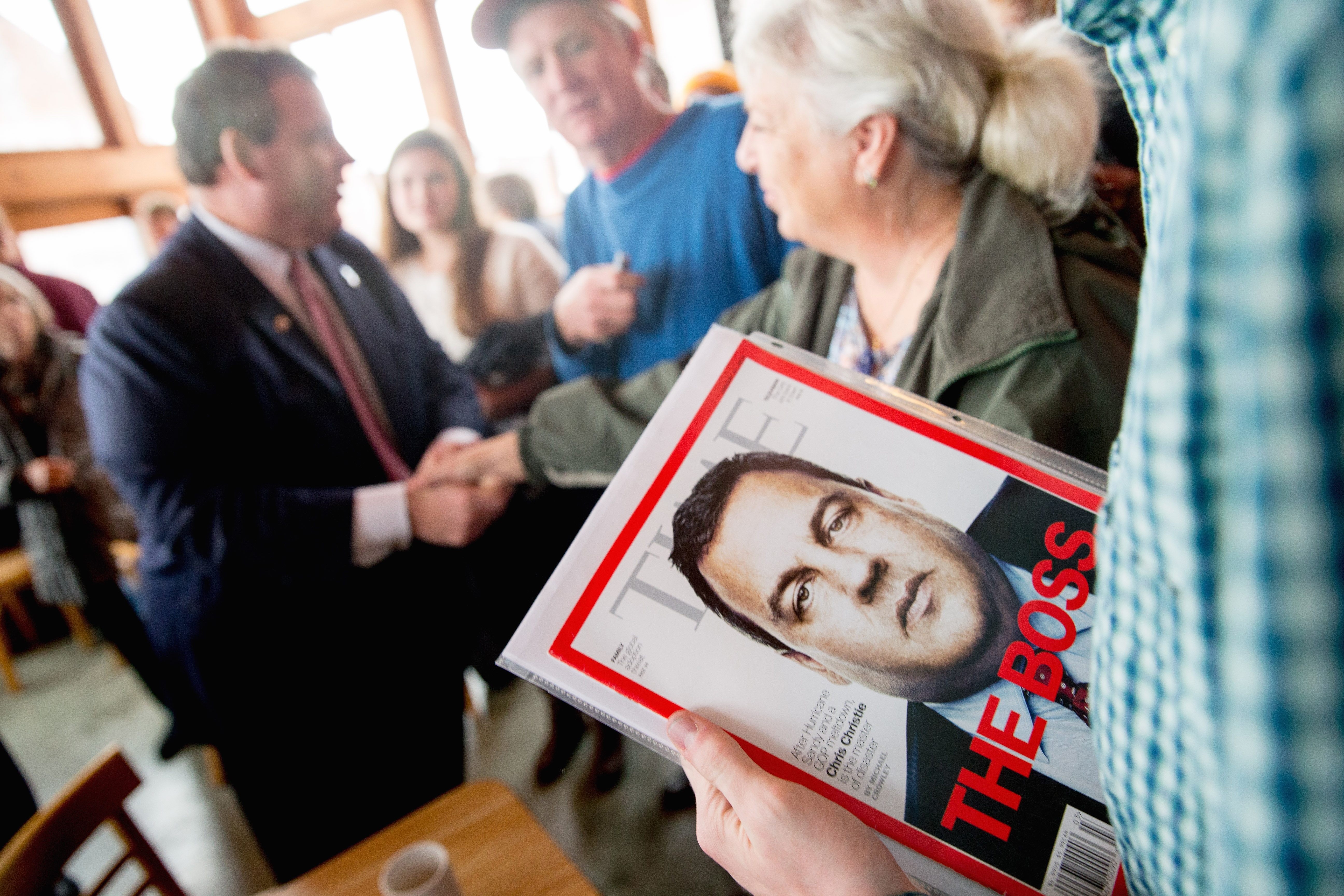 A visitor holds a Time Magazine depicting Republican presidential candidate, New Jersey Gov. Chris Christie after he spoke at Elly's Tea and Coffee House in Muscatine, Iowa, Tuesday, Dec. 29, 2015.