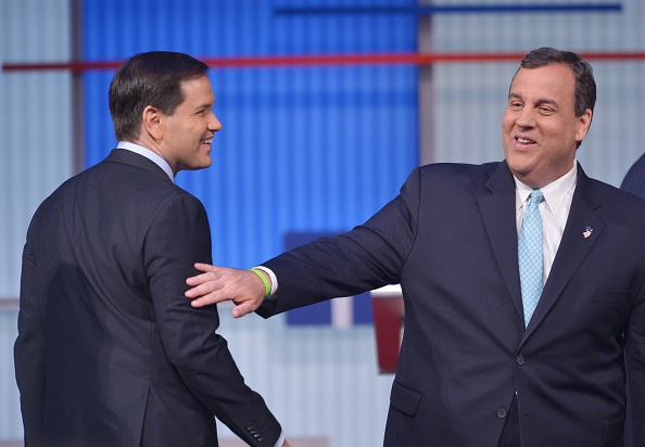 New Jersey Governor Chris Christie (R) chats with Florida Senator Marco Rubio (L) following the prime time Republican presidential  debate on August 6, 2015 at the Quicken Loans Arena in Cleveland, Ohio.