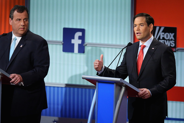 Republican presidential candidates New Jersey Gov. Chris Christie (L) and Sen. Marco Rubio (R-FL) participate in the first prime-time presidential debate hosted by FOX News and Facebook at the Quicken Loans Arena August 6, 2015 in Cleveland, Ohio.