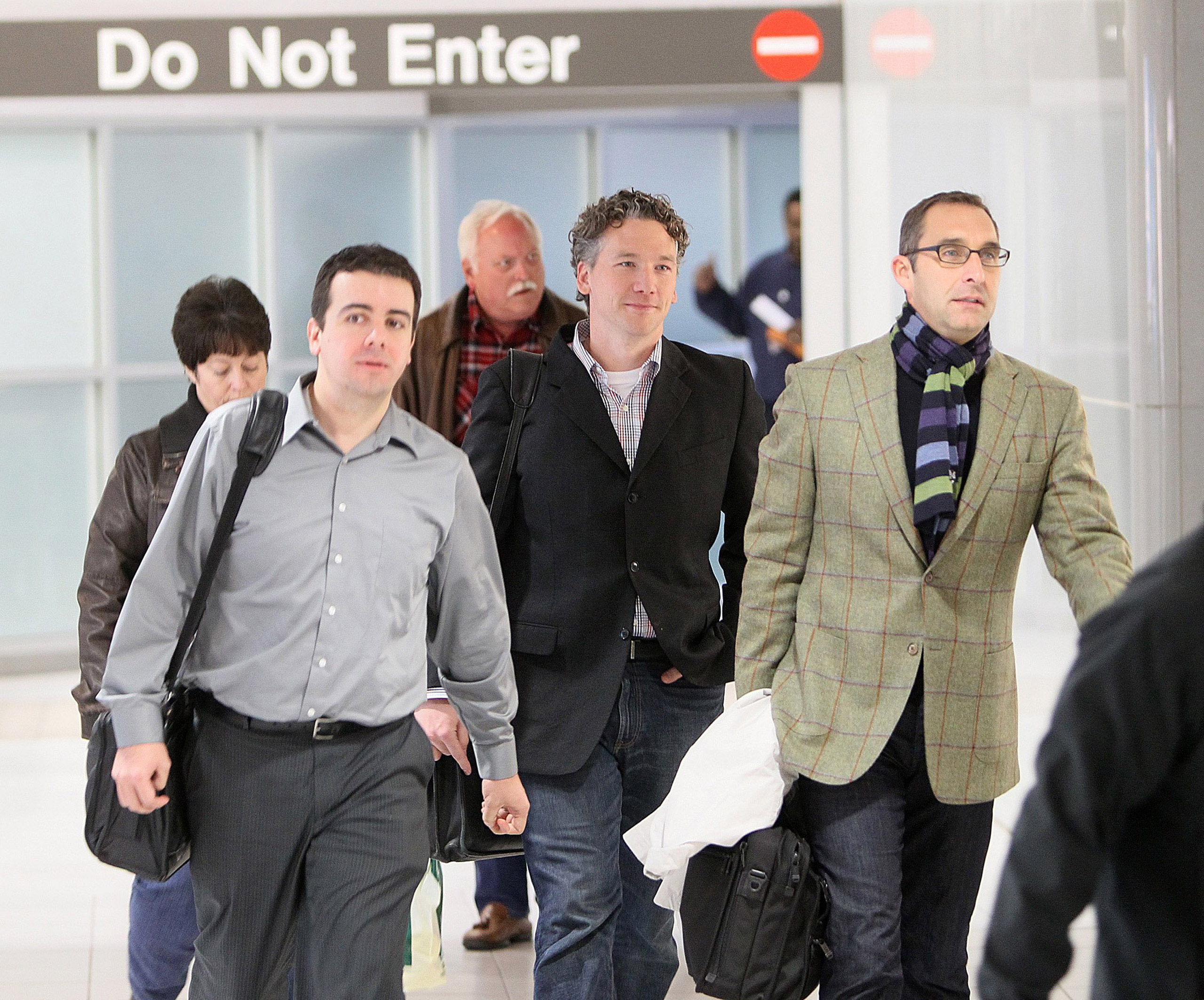 Then-St. Louis Cardinals scouting director Christopher Correa (left), assistant general manager Mike Girsch and general manager John Mozeliak arrive at Lambert-St. Louis International Airport in St. Louis, Mo., on Dec. 8, 2011.