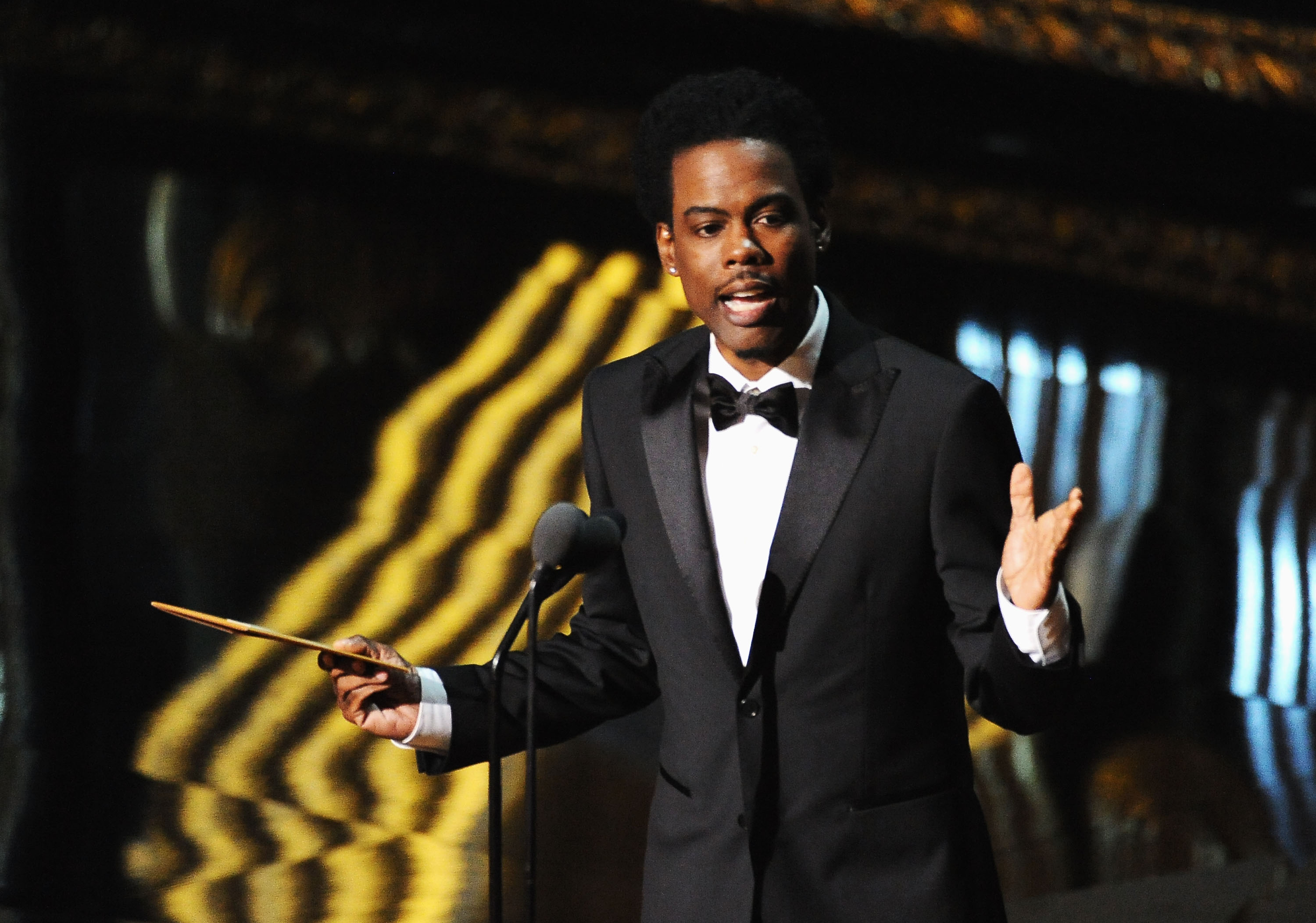 Chris Rock presenting at the Academy Awards in 2012.