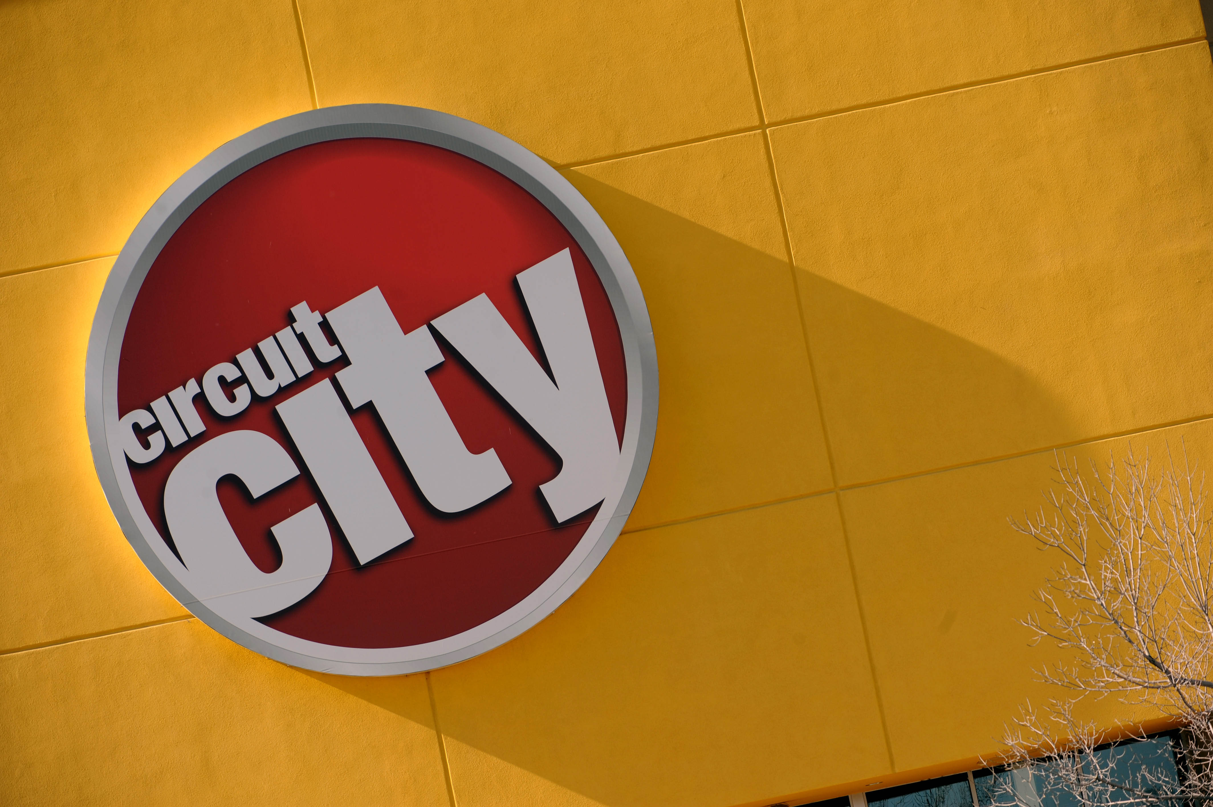 A Circuit City sign hangs outside a store in Denver.