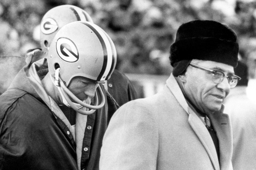 """Temperature: -13°F (Wind Chill: - 48°F) On Dec. 31, 1967, the Green Bay Packers faced the Dallas Cowboys in the """"Ice Bowl"""" at Lambeau Field in Green Bay, Wis. Here, quarterback Bart Starr stands on the sidelines with head coach Vince Lombardi."""