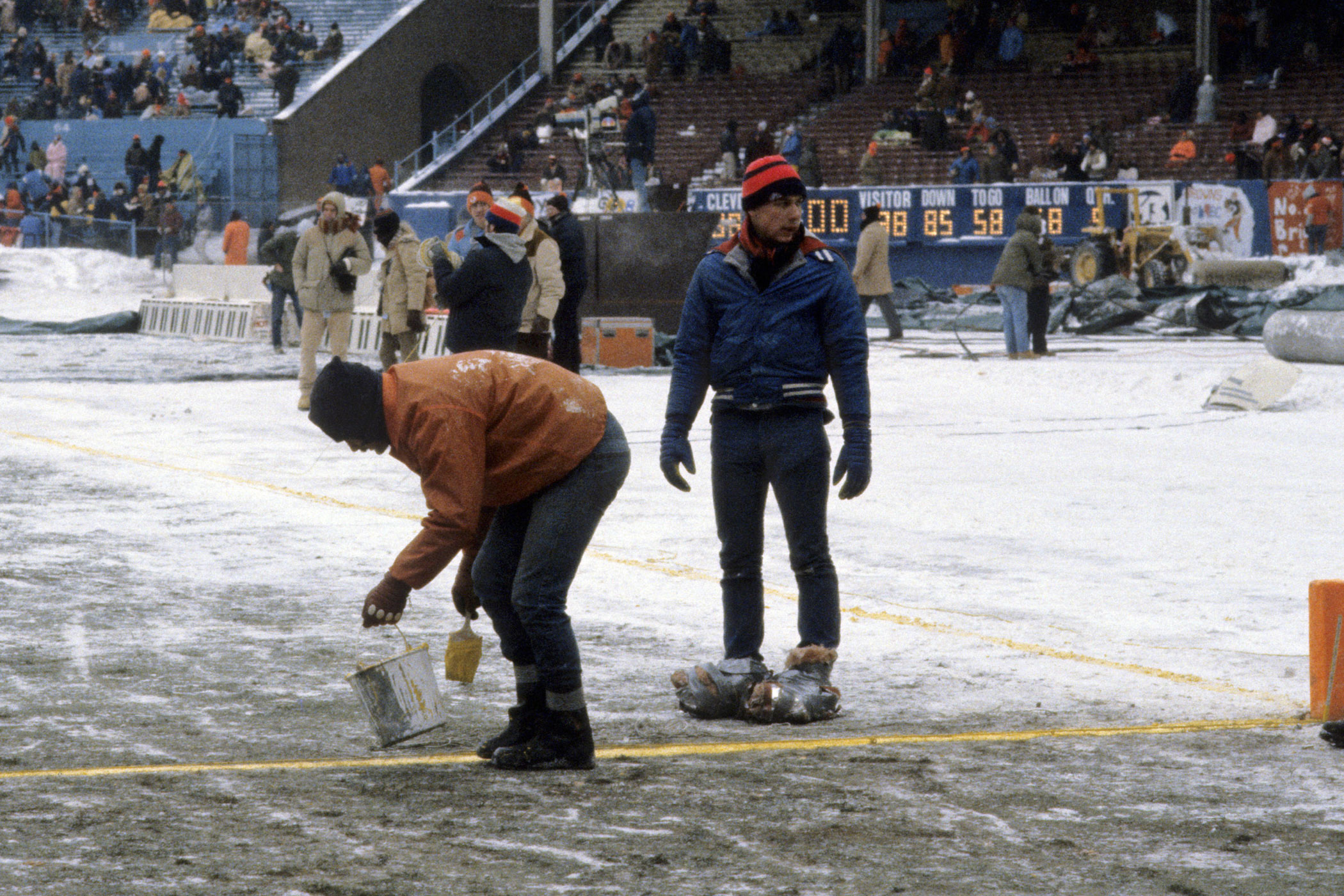 Temperature: -5°F. On Jan. 4, 1981, the Oakland raiders defeated the Cleveland Browns in a subzero NFL football playoff game. Here, a member of the grounds crew retouches the frosty field at Cleveland Municipal Stadium in Cleveland.