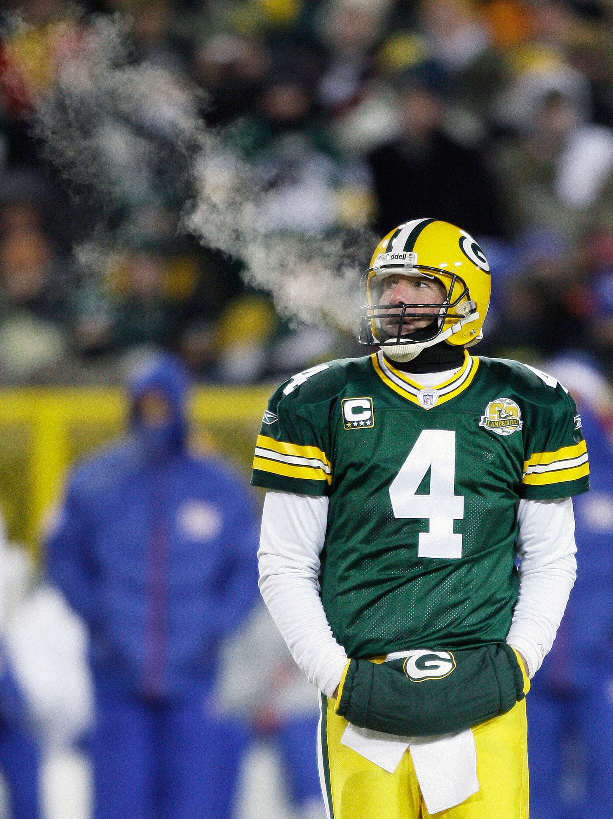 Temperature: -4°F (Wind Chill: -24°F).                               On Jan. 20, 2008, the Green Bay Packers faced the New York Giants in a frigid NFC championship football game. Here, Packers quarterback Brett Favre warms his hands at  Lambeau Field in Green Bay, Wis.
