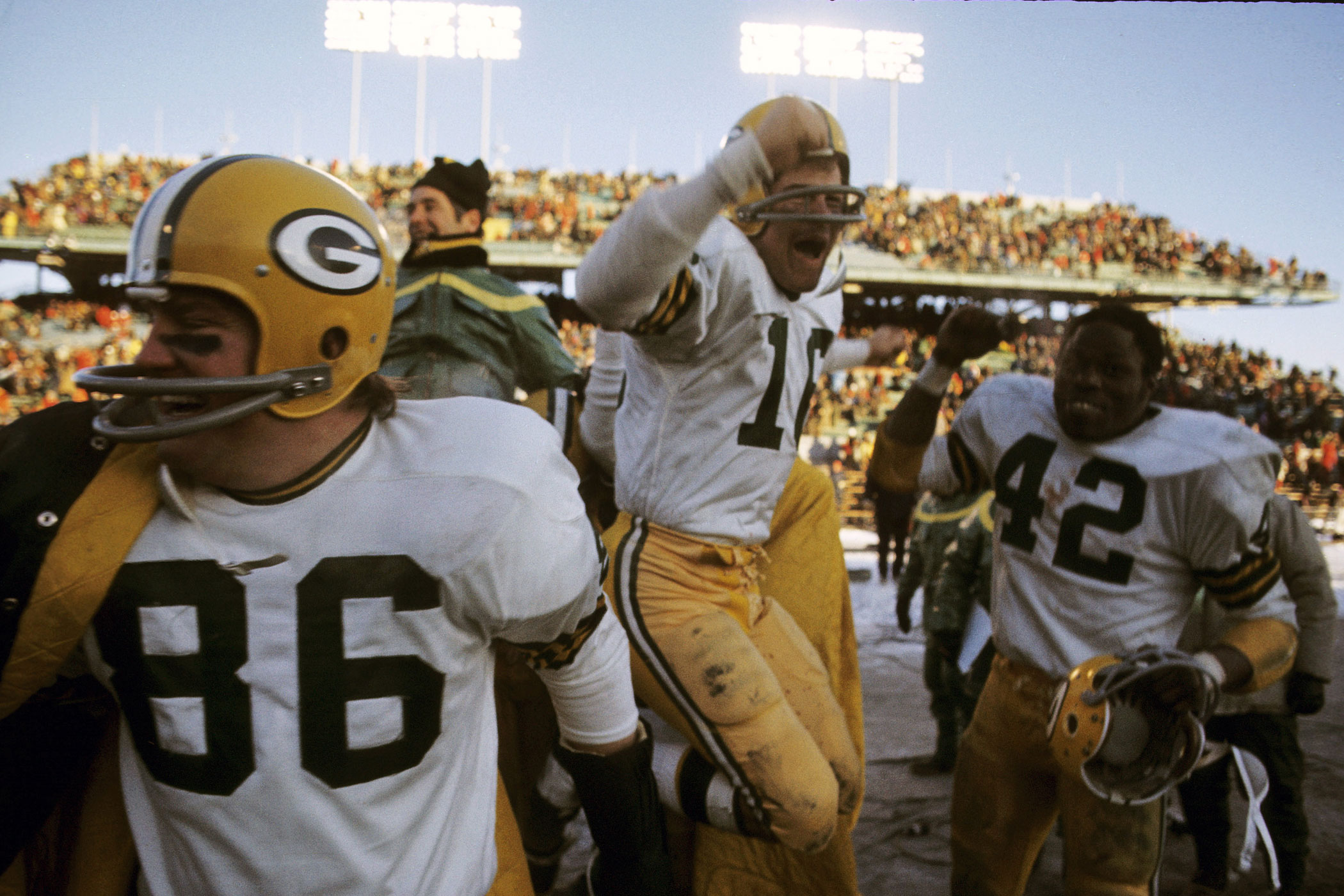 Temperature: 0°F (Wind Chill: -18°F).                               On Dec. 10, 1972, the Green Bay Packers faced the Minnesota Vikings in an NFL football game. Here, tight end Pete Lammons (86), quarterback Scott Hunter (16), and running back John Brockington (42) celebrate the Packer's victory at Metropolitan Stadium in Bloomington, Minn.