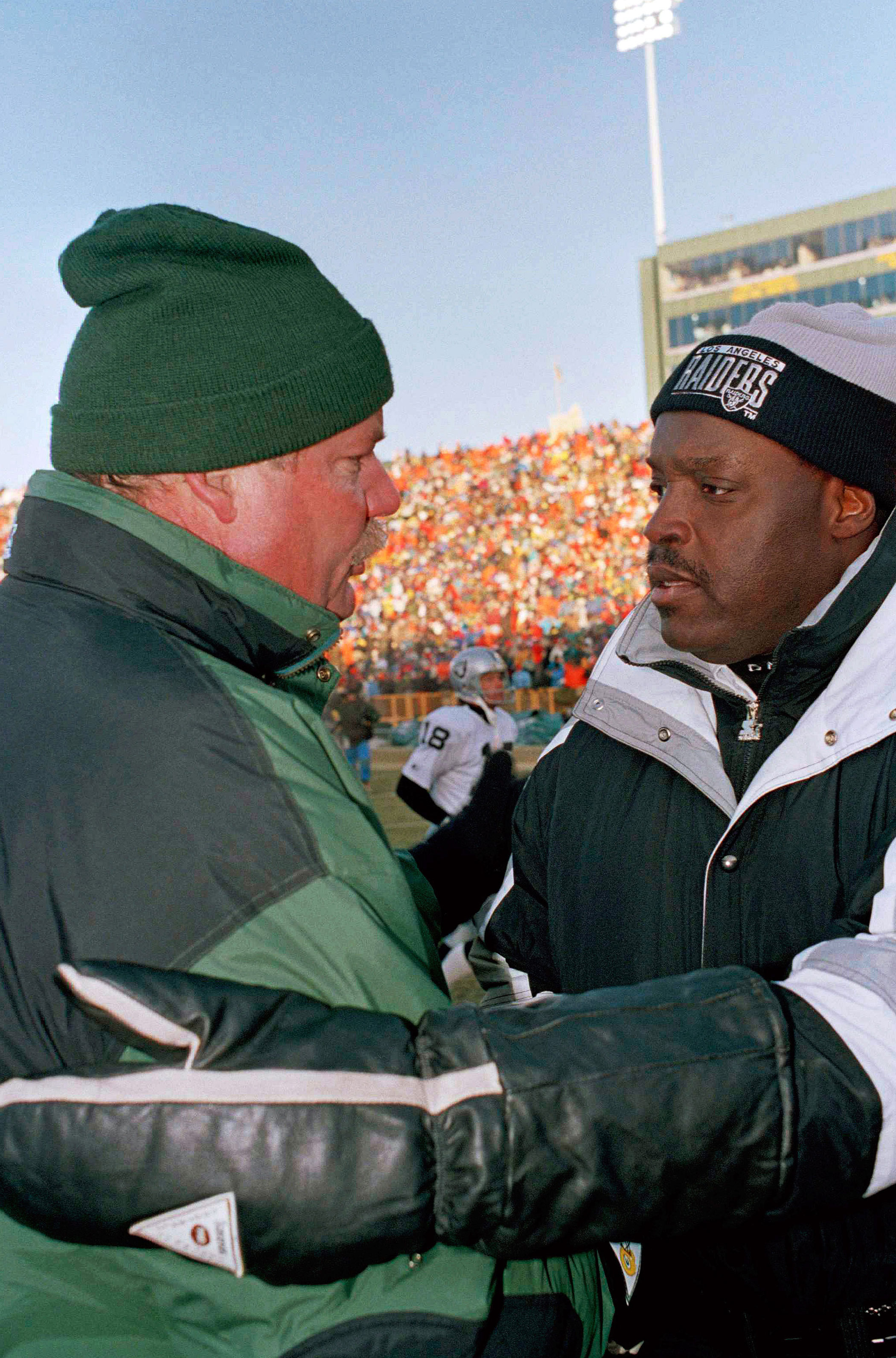 Temperature: 0°F.                               On Dec. 26, 1993, the Green Bay Packers faced the Los Angeles Raiders in an NFL football game. Here, coaches Mike Holmgran and Art Shell greet each other in Green Bay, Wis.