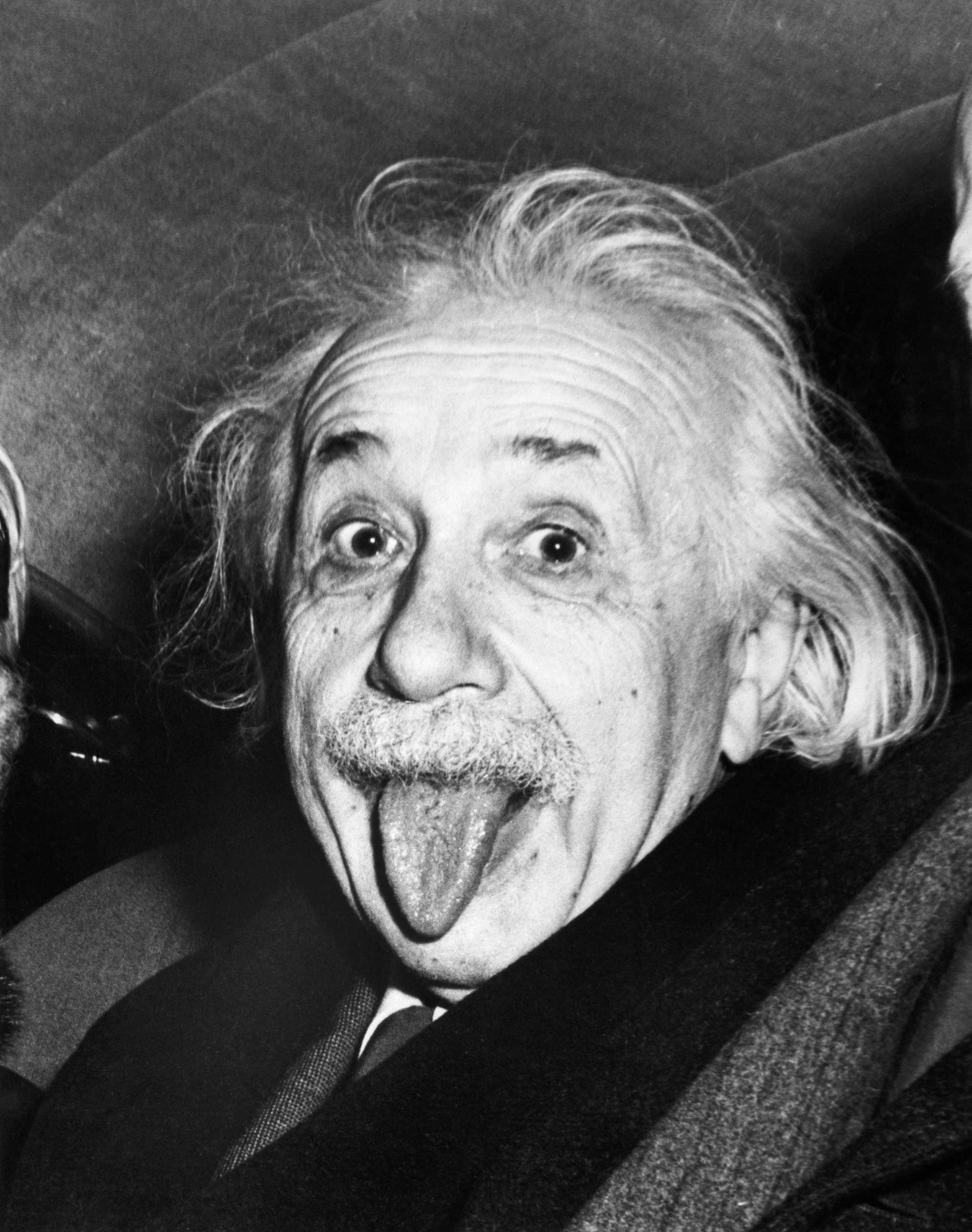 Albert Einstein sticks out his tongue when asked by photographers to smile on the occasion of his 72nd birthday on March 14, 1951. Princeton, NJ.