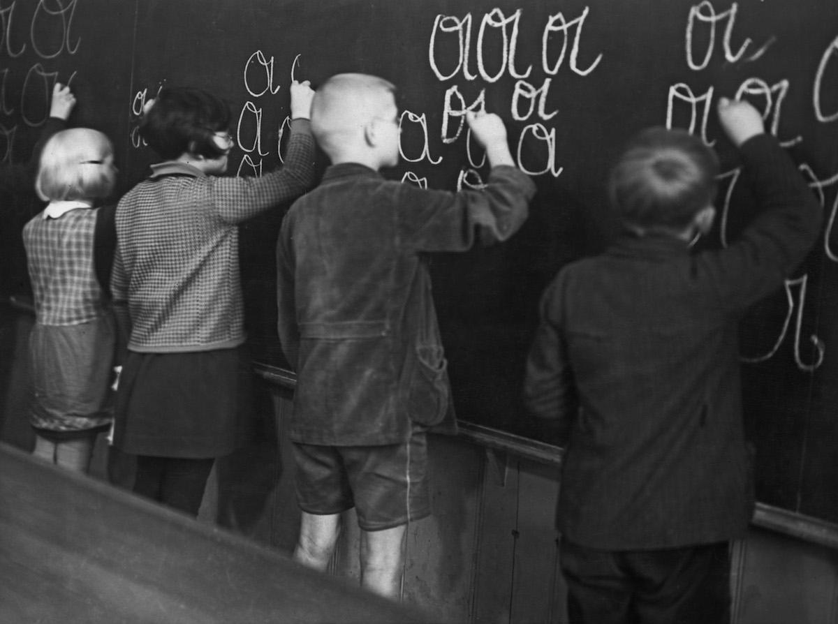 German children work on their handwriting, circa 1950.