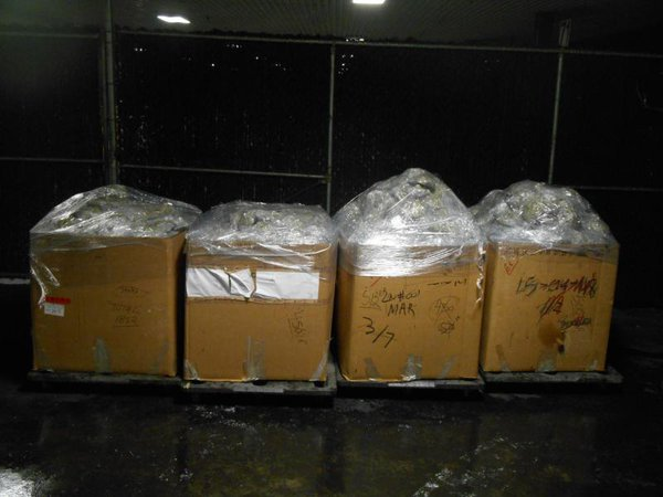 Boxes of bundles containing 2,072 pounds of marijuana seized by CBP officers at World Trade Bridge